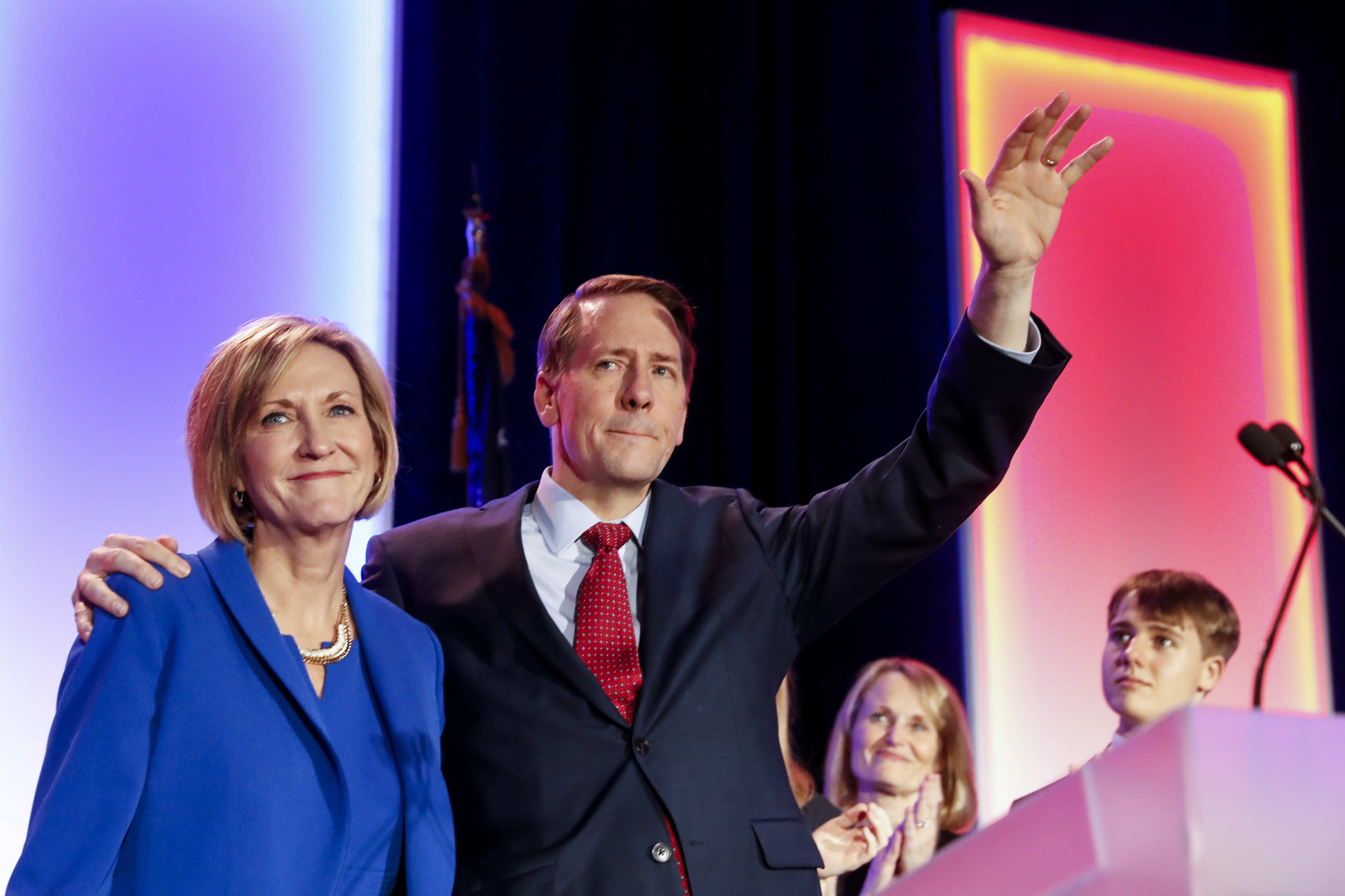 Ohio Democratic gubernatorial candidate Richard Cordray, right, waves to the crowd alongside his running mate Betty Sutton, left, after conceding defeat to Ohio Republican gubernatorial candidate Mike DeWine during the Ohio Democratic Party election night watch party, Tuesday in Columbus, Ohio. (AP Photo/John Minchillo)