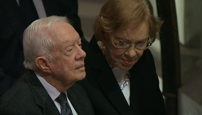 Former President Jimmy Carter and former first lady Rosalynn Carter are seated in the first row at Washington National Cathedral at the funeral of former President George H.W. Bush on Wednesday.