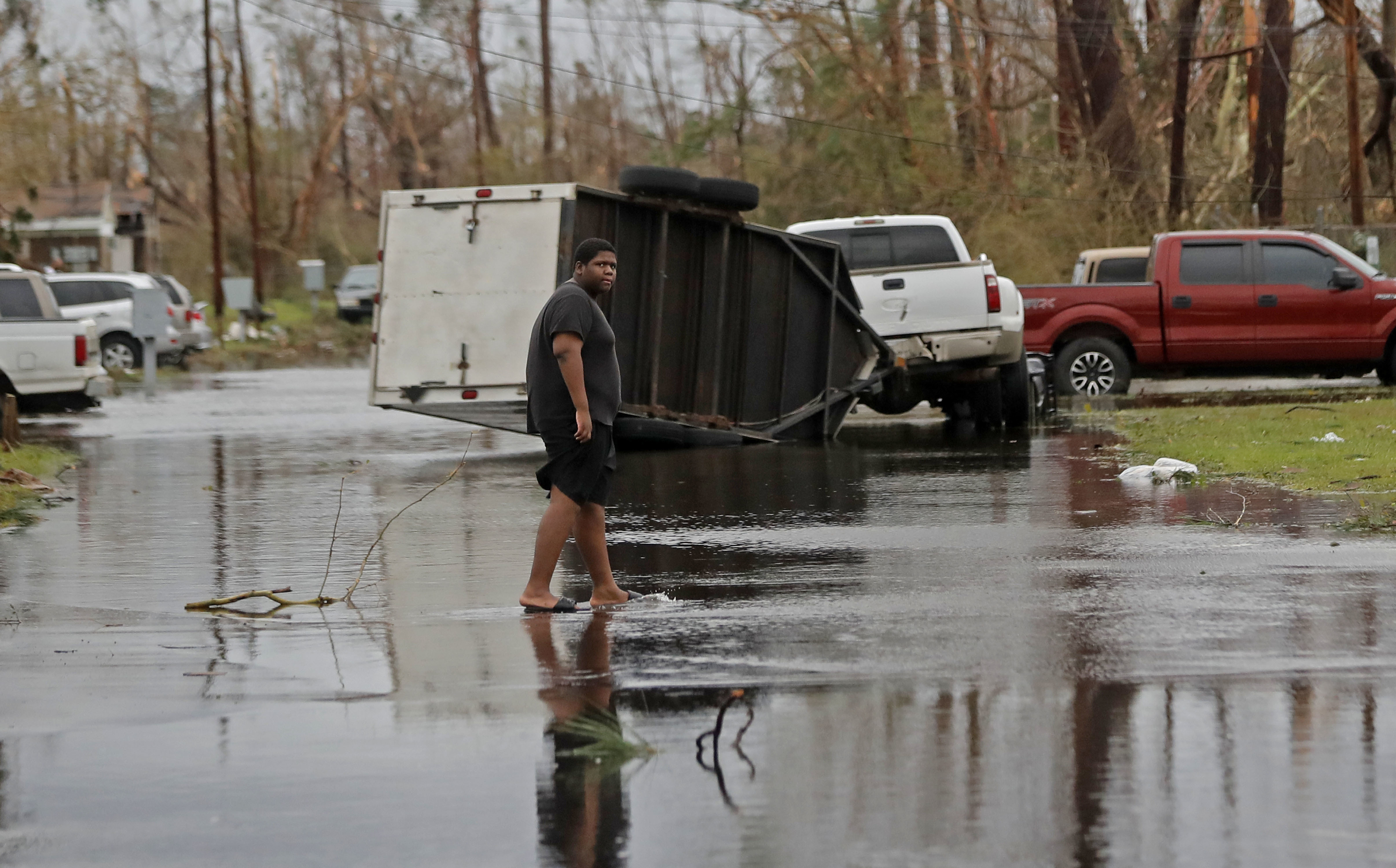 A man walks in the street of his heavily damaged neighborhood in the aftermath of Hurricane Michael in Panama City, Fla., Wednesday, Oct. 10, 2018. Supercharged by abnormally warm waters in the Gulf of Mexico, Hurricane Michael slammed into the Florida Panhandle with terrifying winds of 155 mph Wednesday, splintering homes and submerging neighborhoods. (AP Photo/Gerald Herbert)