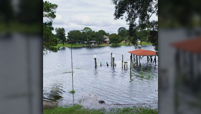 This photo provided by April Sarver shows a flooded neighborhood boat dock in Fort Walton Beach, Fla., Tuesday, Oct. 9, as a fast and furious Hurricane Michael sped toward the Florida Panhandle, giving tens of thousands of people precious little time to get out or board up. (April Sarver via AP)