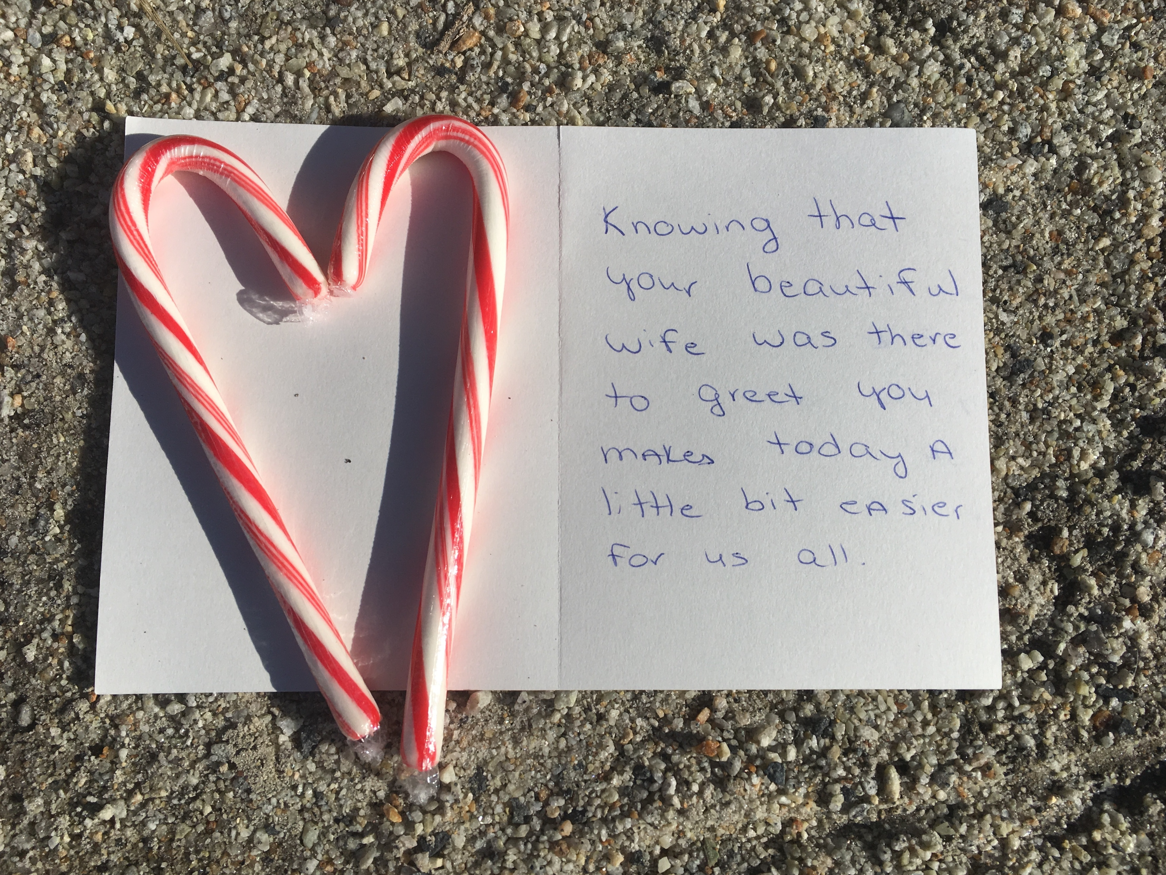 A note for President George H. W. Bush is seen at a makeshift memorial across from Walker's Point, the Bush's summer home, Saturday, Dec. 1, 2018, in Kennebunkport, Maine.