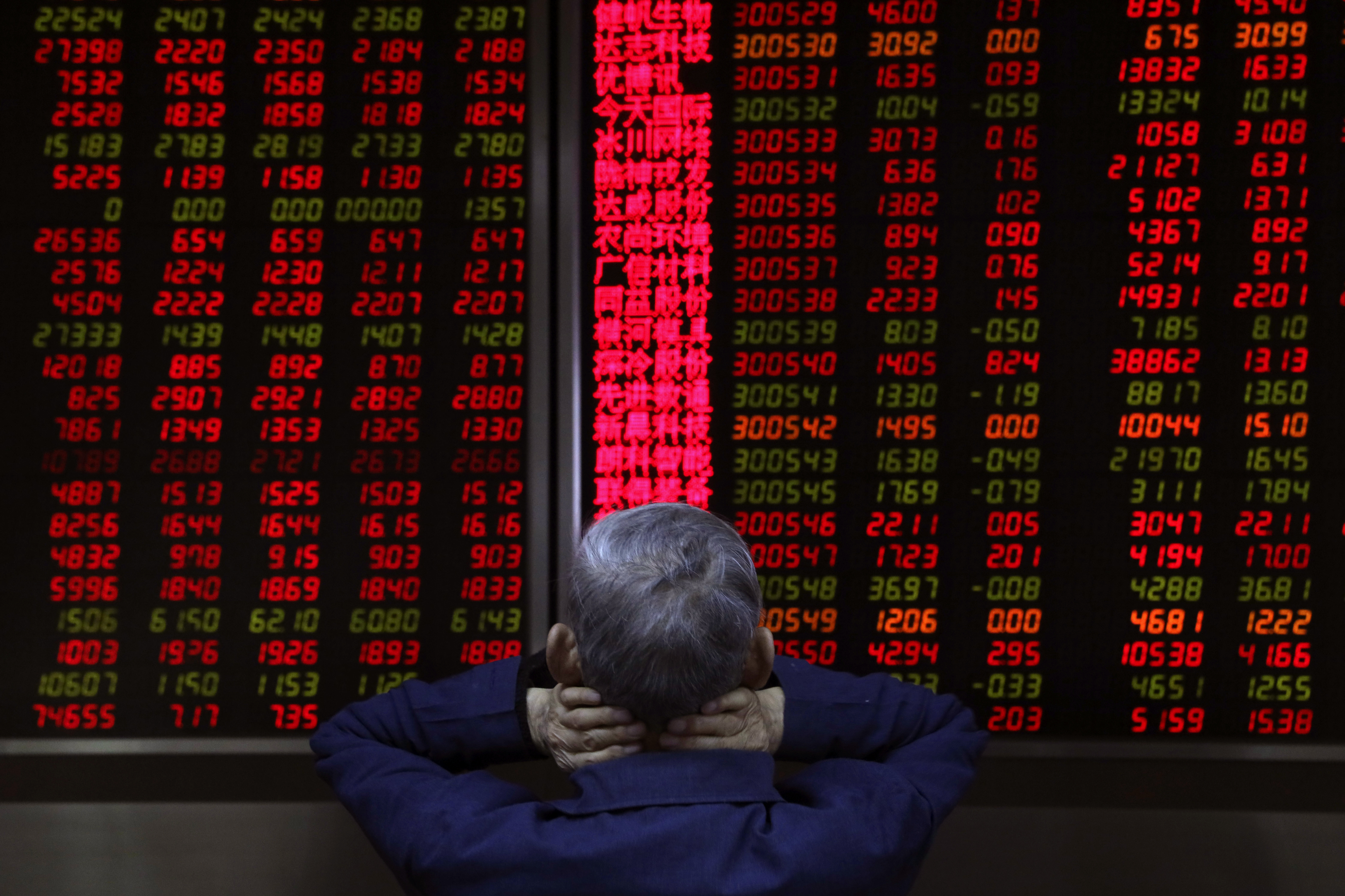 A man monitors stock prices at a brokerage in Beijing, China, Thursday, Nov. 8, 2018. Asian markets rose on Thursday after the U.S. midterm elections went as expected, soothing fears of a sudden shift on trade and economic policies.(AP Photo/Ng Han Guan)