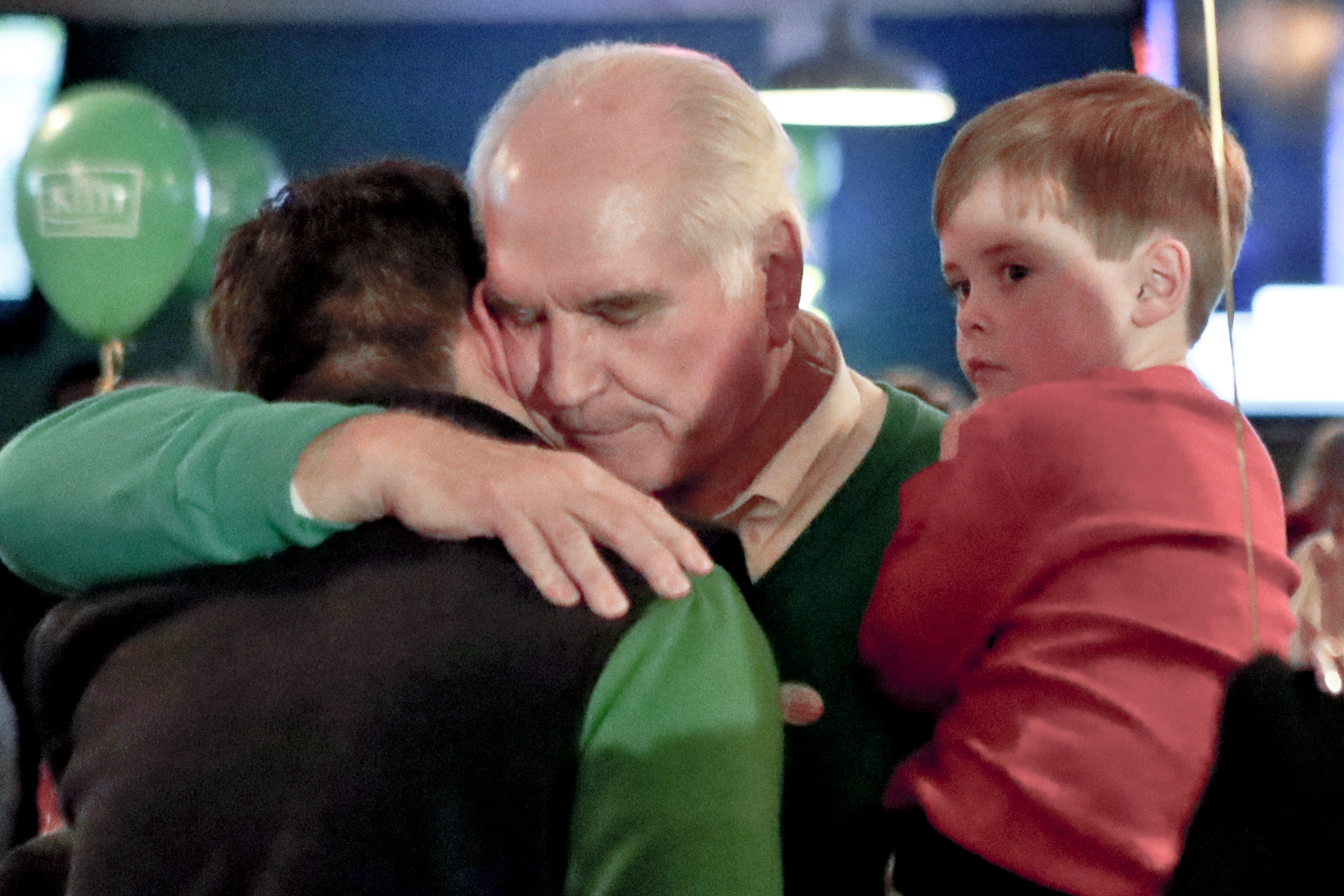 U.S. Rep. Mike Kelly, center, holds his grandson Isaac Kelly, 4, as he hugs his chief of staff, Matt Stroia, left, after hearing his opponent had conceded the election on Tuesday, Nov. 6, 2018 in Butler, Pa. Kelly faced democratic challenger Ron DiNicola in the newly redrawn 16th district in Pennsylvania. (AP Photo/Keith Srakocic)
