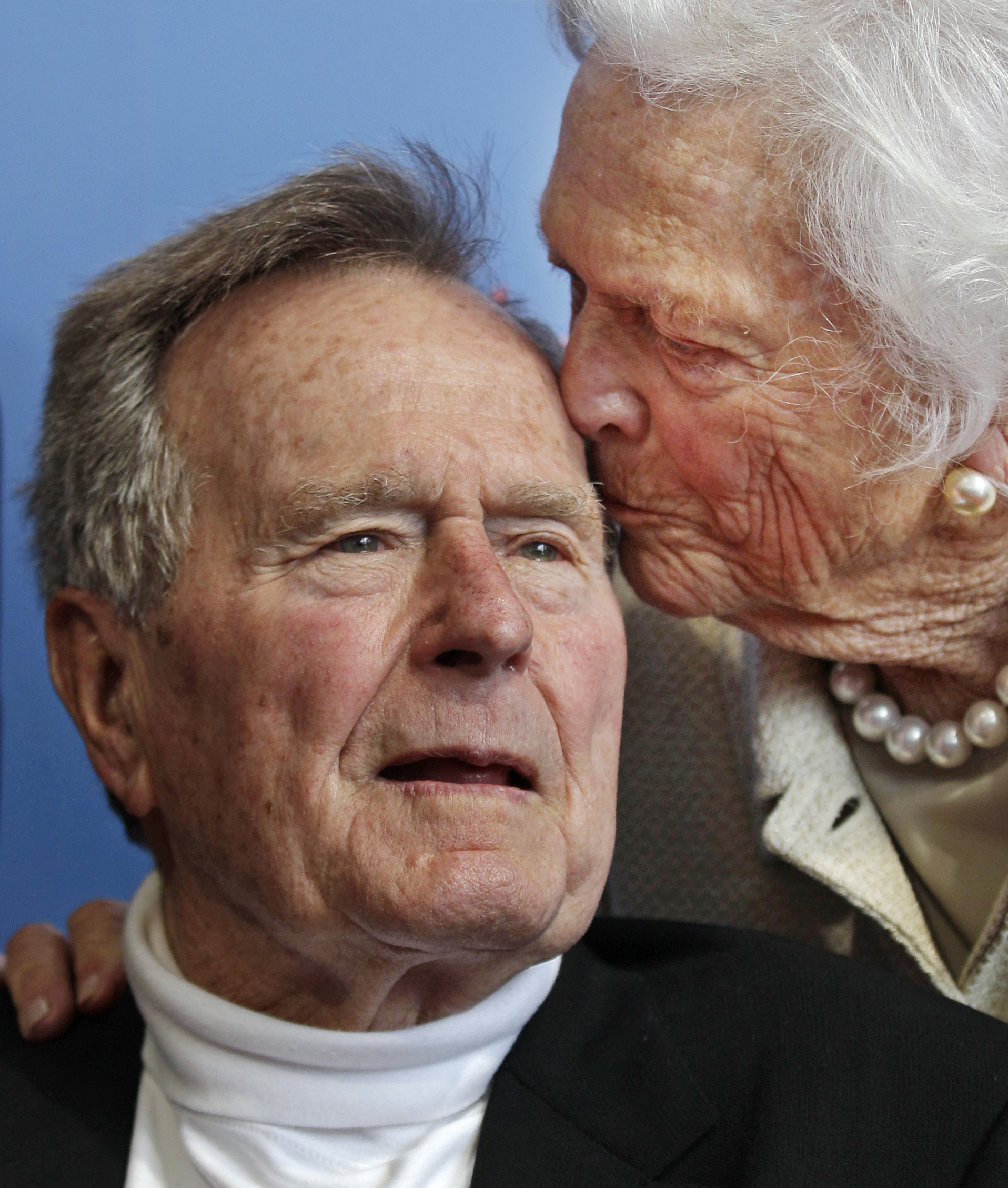 FILE - In this June 12, 2012 file photo, former President George H.W. Bush, and his wife, former first lady Barbara Bush, arrive for the premiere of HBO's new documentary on his life near the family compound in Kennebunkport, Maine. Bush has died at age 94. Family spokesman Jim McGrath says Bush died shortly after 10 p.m. Friday, Nov. 30, 2018, about eight months after the death of his wife, Barbara Bush. (AP Photo/Charles Krupa, File)