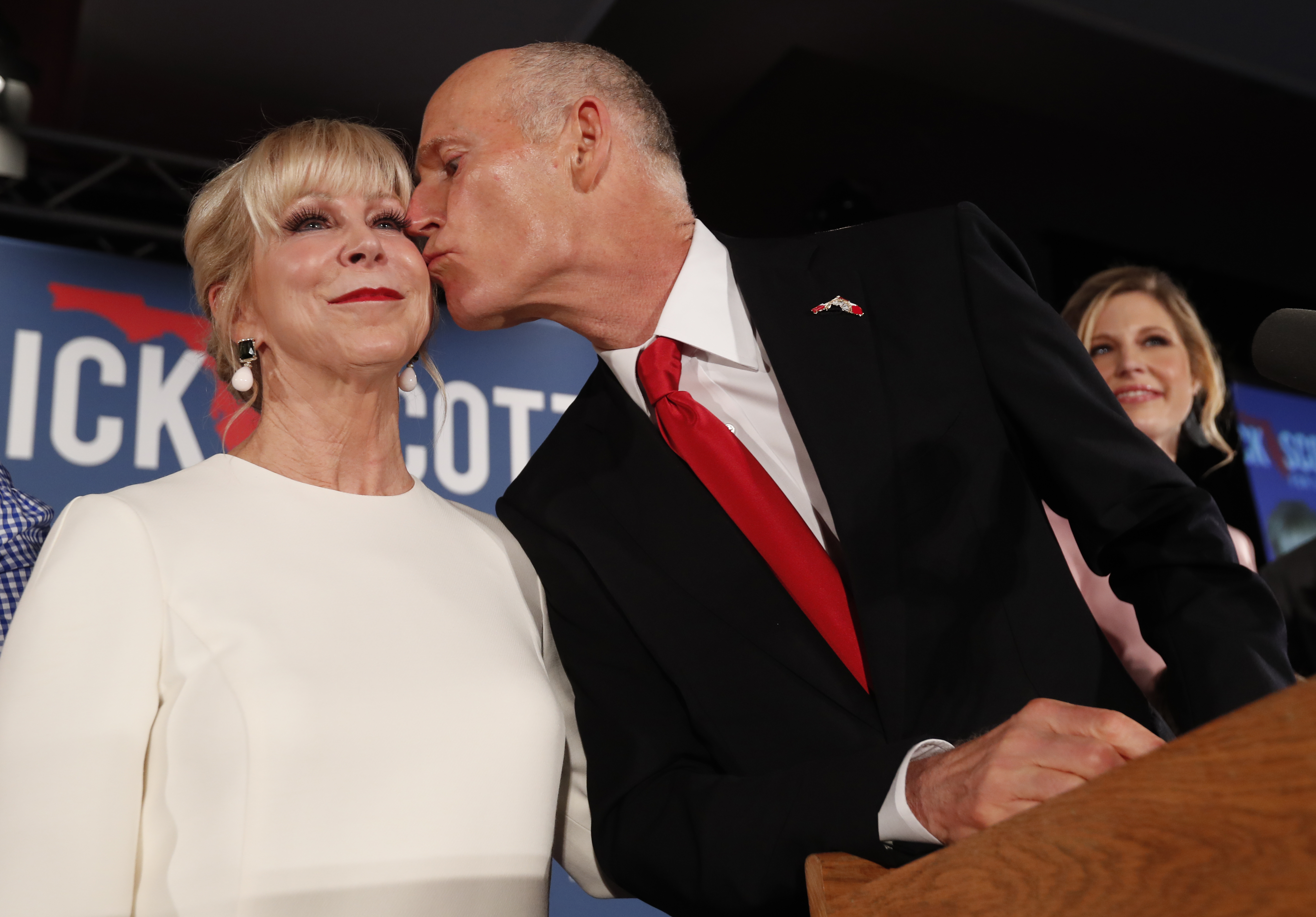 Republican Senate candidate Rick Scott kisses his wife Ann as he speaks to supporters at an election watch party. He was ahead as of midnight on Nov. 7, but the race hasn't been called and appears to be headed for a runoff.