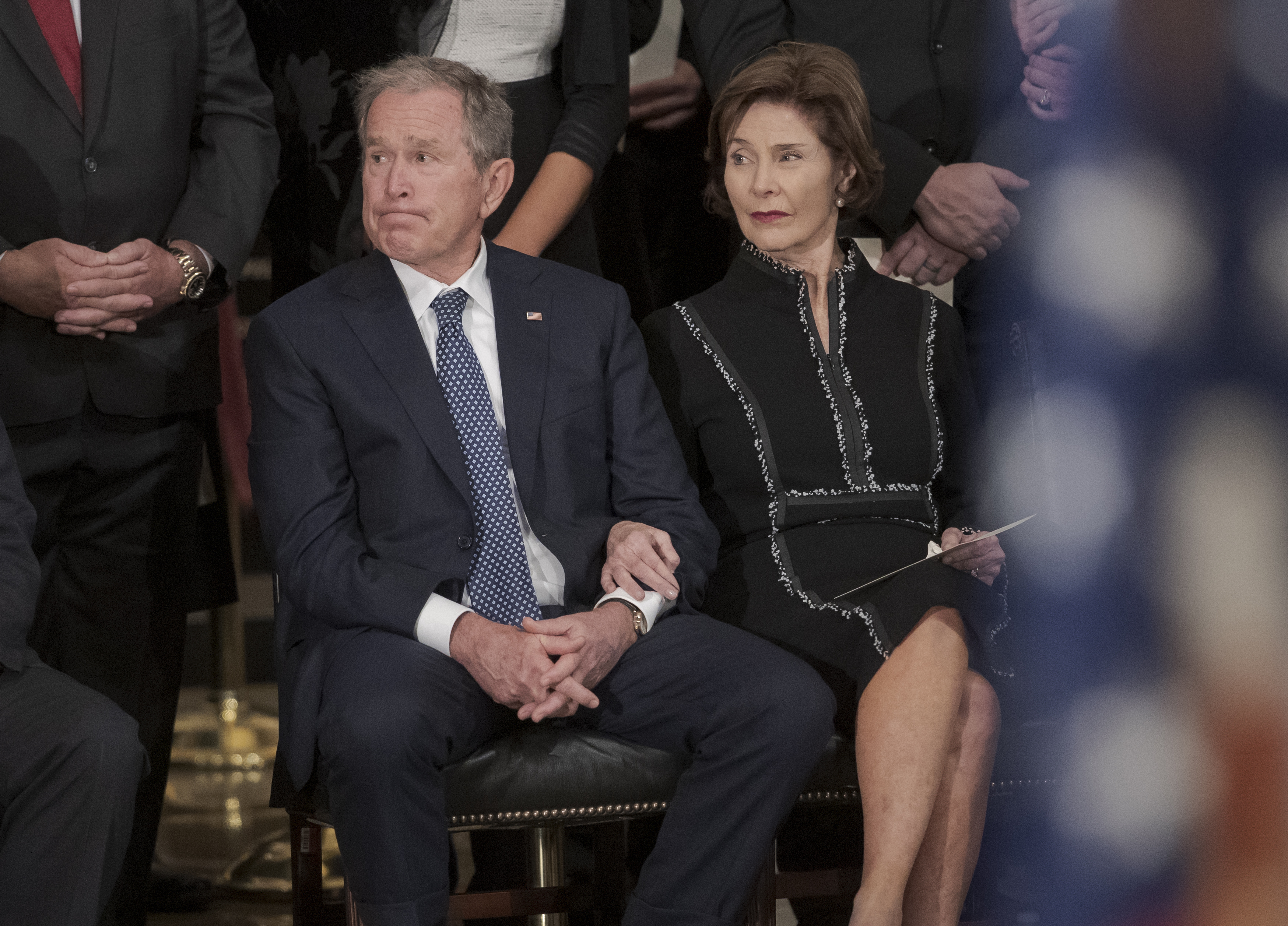 Former President George W. Bush, with former first lady Laura Bush, listens to eulogies for his father, President George H.W. Bush, as he lies in state at the Capitol Rotunda where in Washington, Monday, Dec. 3, 2018. (AP Photo/J. Scott Applewhite)