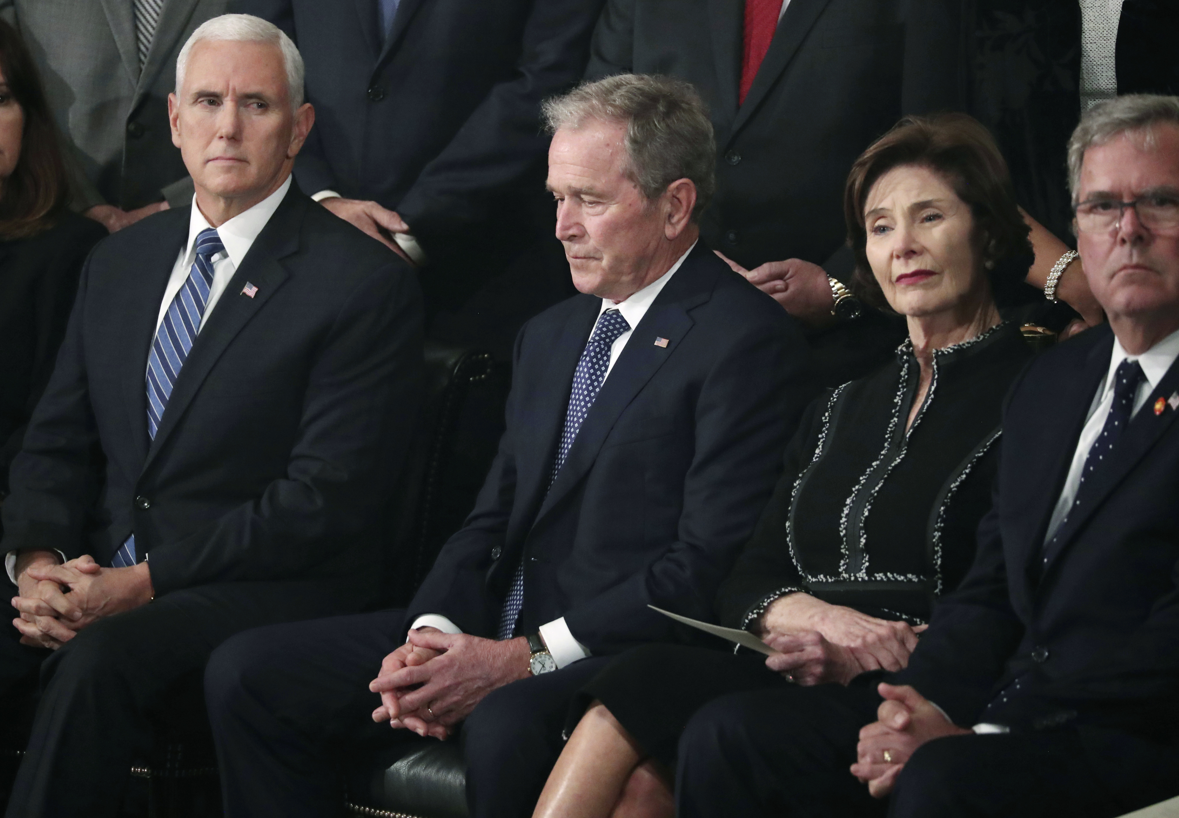Former President George W. Bush, second from left, former first lady Laura Bush, former Florida Gov. Jeb Bush, right, and Vice President Mike Pence, left, attend a service for former President George H.W. Bush as his body lies in state in the Capitol Rotunda, Monday, Dec. 3, 2018 in Washington. (Jonathan Ernst/Pool via AP)
