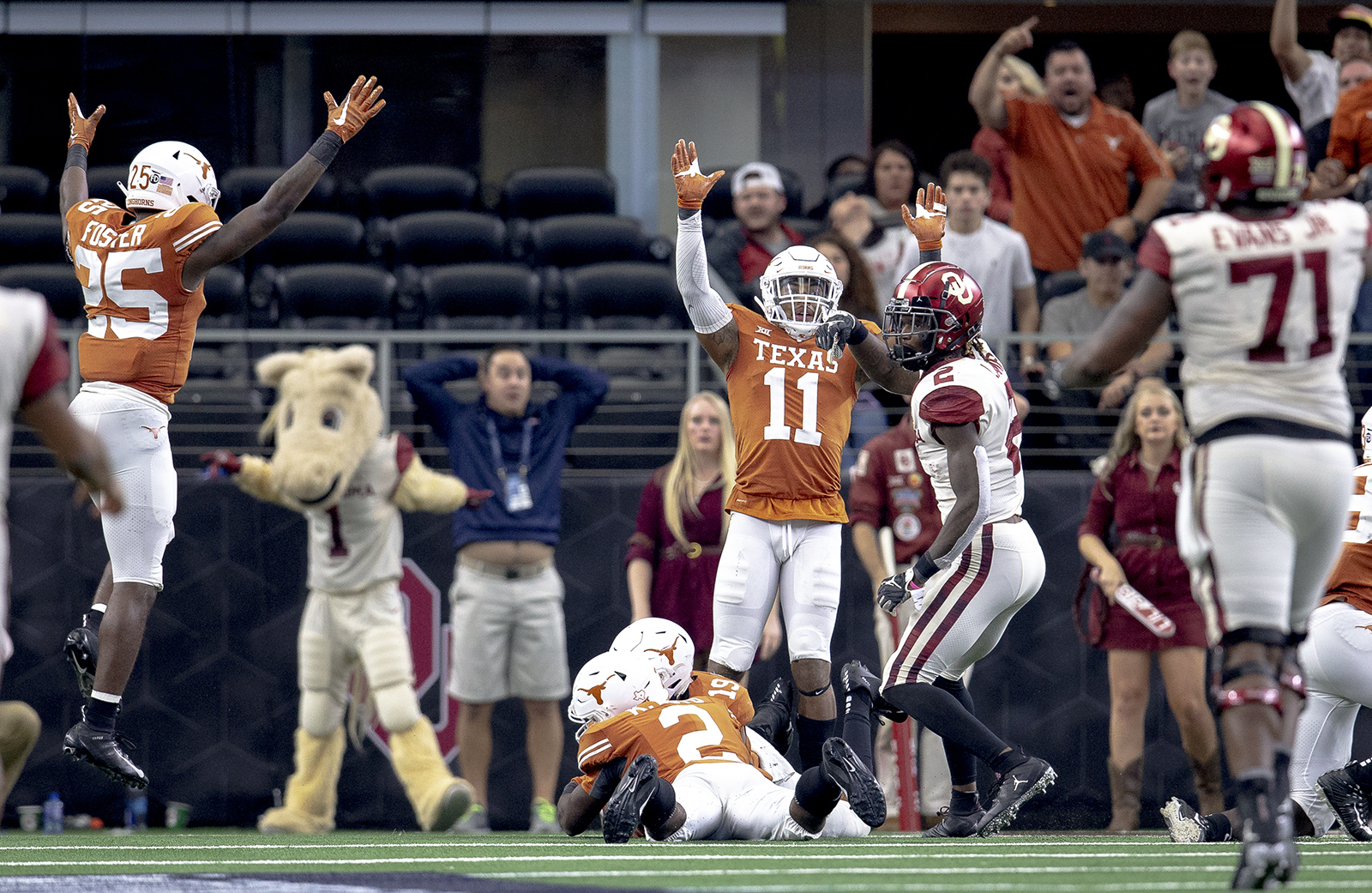 Texas players celebrate after defensive back Brandon Jones (19) recovered a fumble by Oklahoma wide receiver CeeDee Lamb (2) during the Big 12 Conference championship NCAA college football game in Arlington, Texas, on Saturday, Dec. 1, 2018. (Nick Wagner/Austin American-Statesman via AP)