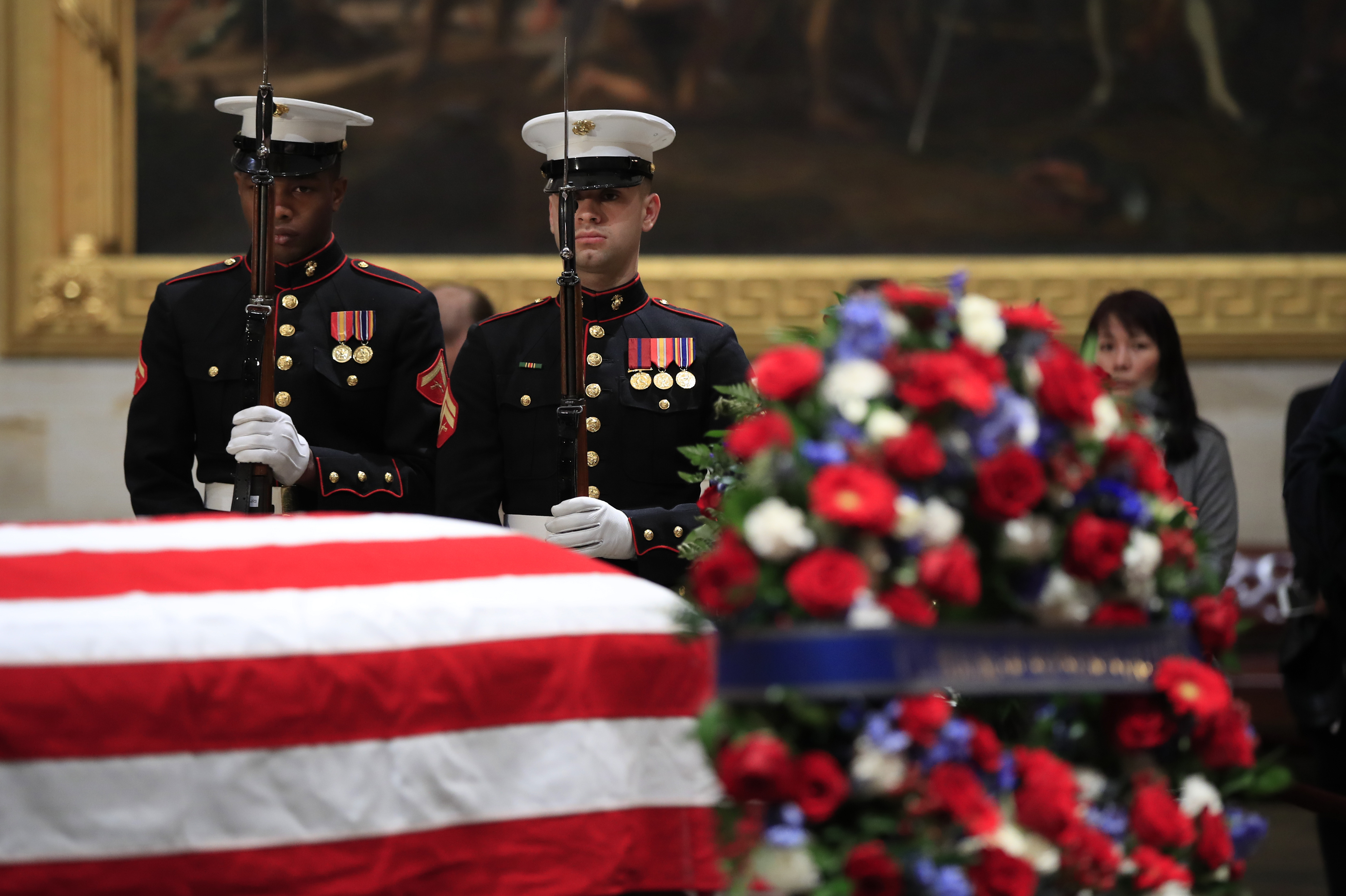 U.S. Marine Corps honor guard execute a rifle salute during the changing of the guard at the Capitol Rotunda where former President George H.W. Bush lies in state Wednesday, Dec. 5, 2018. (AP Photo/Manuel Balce Ceneta)