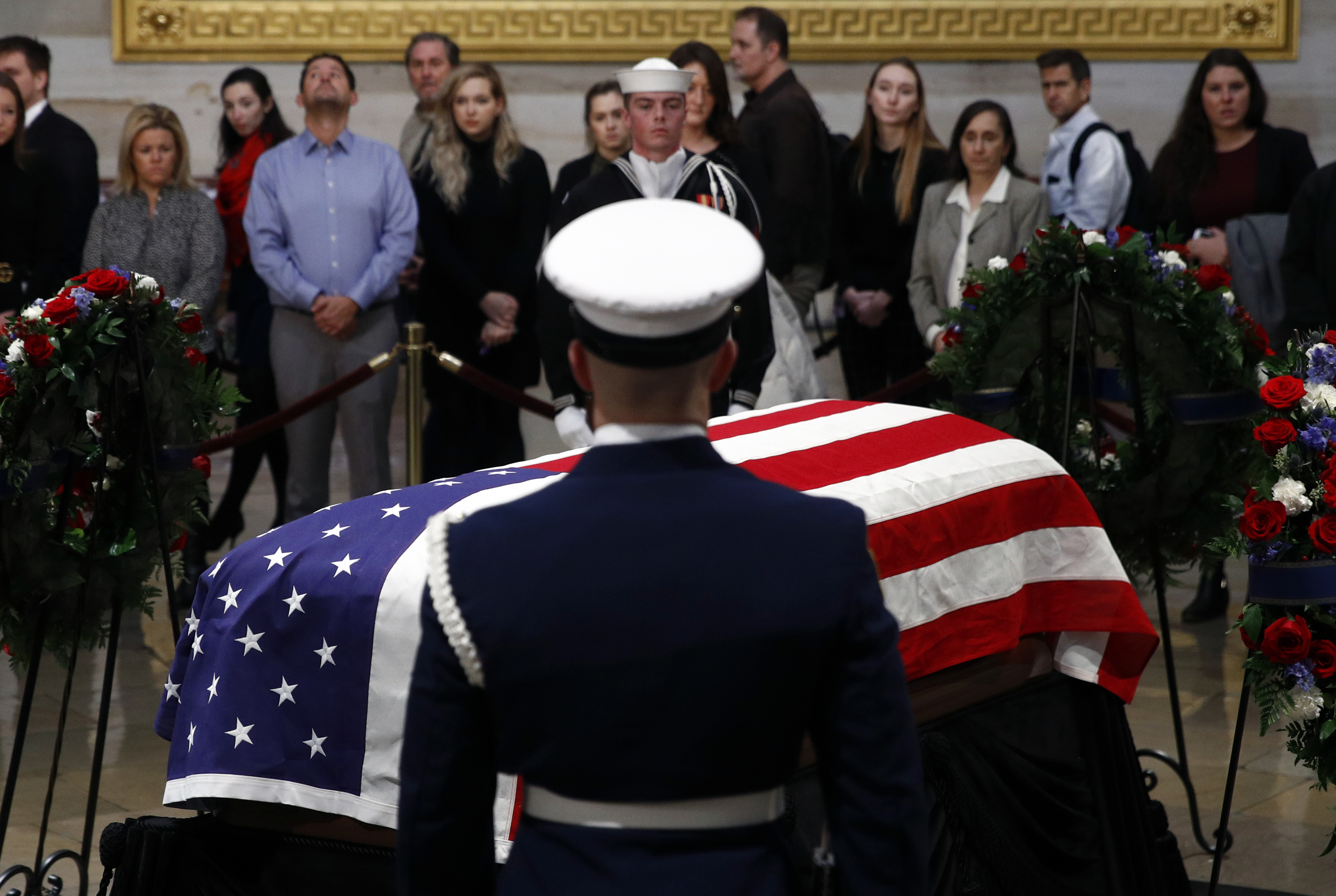 The flag-draped casket of former President George H.W. Bush lies in state in the Capitol Rotunda in Washington, Tuesday, Dec. 4, 2018. (AP Photo/Patrick Semansky)
