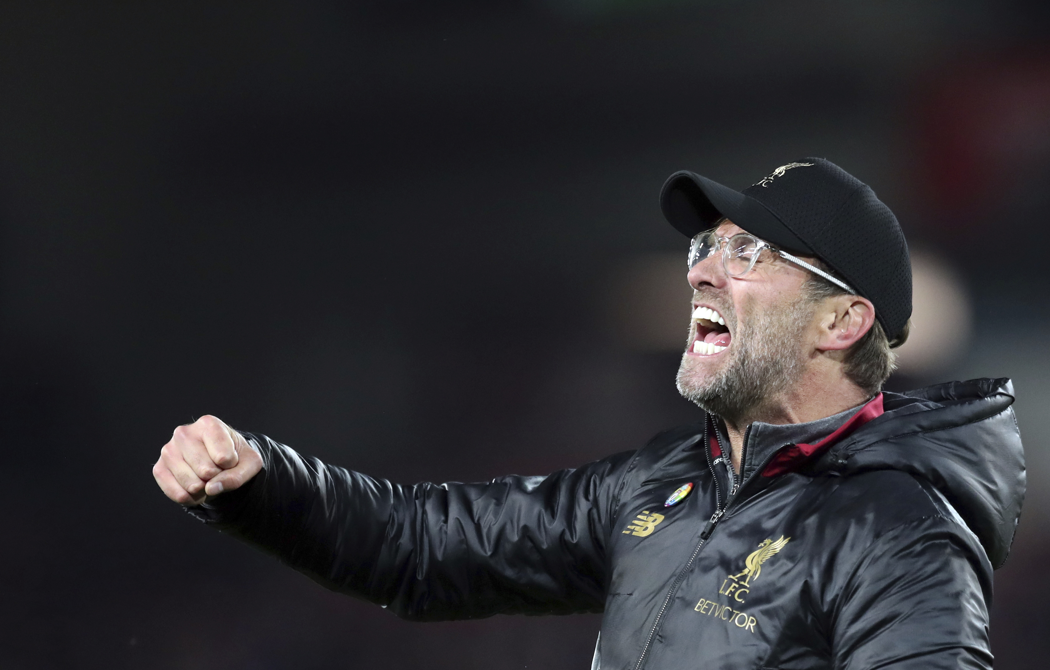 Liverpool coach Juergen Klopp celebrates after Liverpool forward Divock Origi scored his side's first goal during the English Premier League soccer match between Liverpool and Everton at Anfield Stadium in Liverpool, England, Sunday, Dec. 2, 2018. (AP Photo/Jon Super)