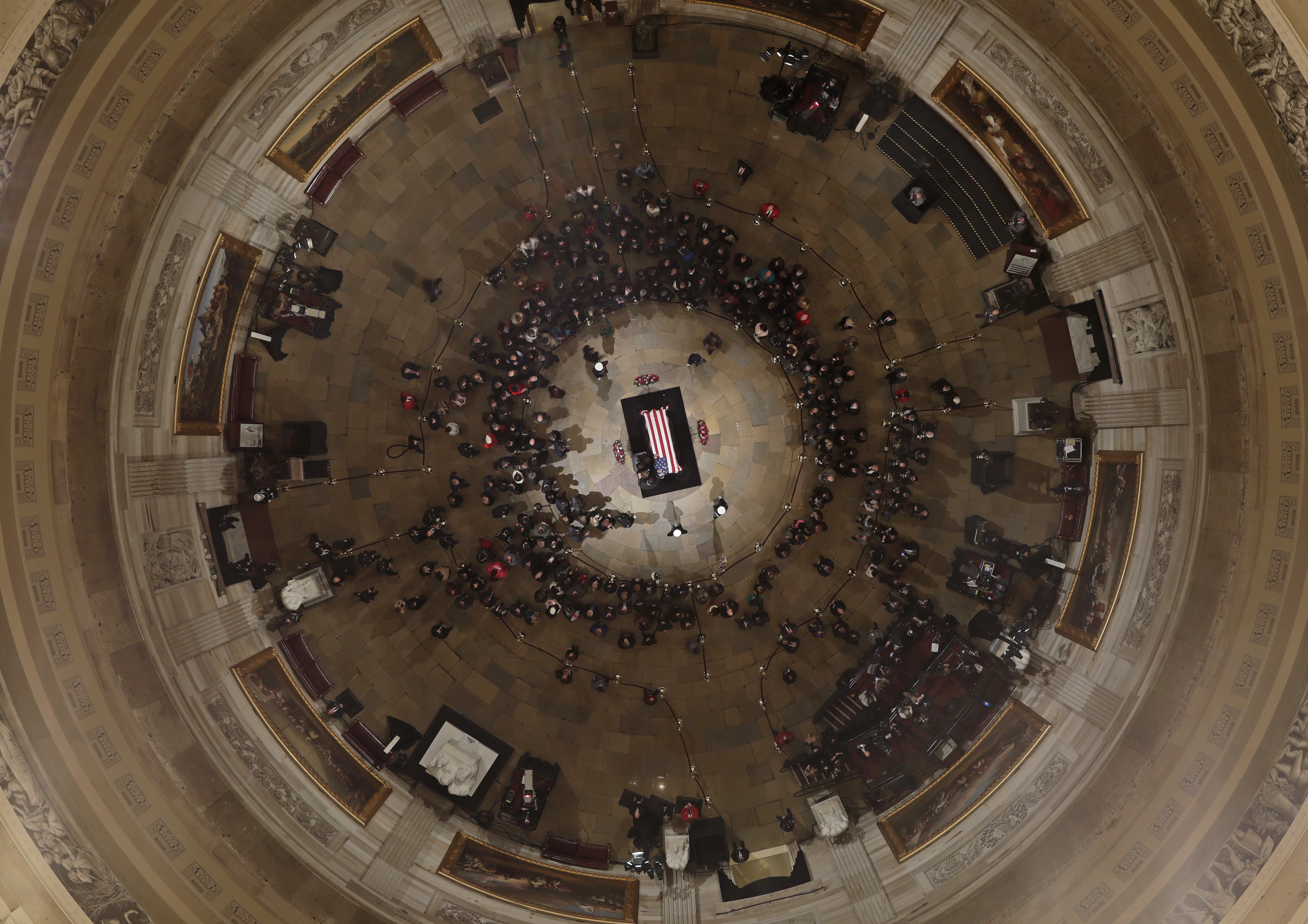 Members of the Bush family gather near the casket of Former President George H. W. Bush as he lies in state in the U.S. Capitol Rotunda Tuesday, Dec. 4, 2018, in Washington. (AP Photo/Morry Gash, Pool)