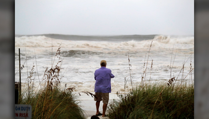 People photograph the surf from encroaching Hurricane Michael, which is expected to make landfall today, in Panama City Beach, FL, Wednesday, Oct. 10. (AP Photo/Gerald Herbert)