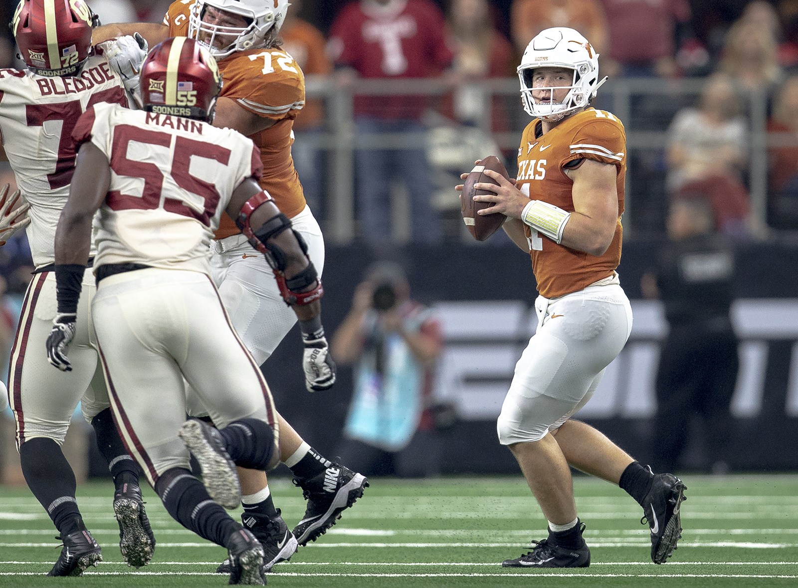 Texas quarterback Sam Ehlinger (11) looks for an open receiver during the Big 12 Conference championship NCAA college football game against Oklahoma in Arlington, Texas, on Saturday, Dec. 1, 2018. (Nick Wagner/Austin American-Statesman via AP)