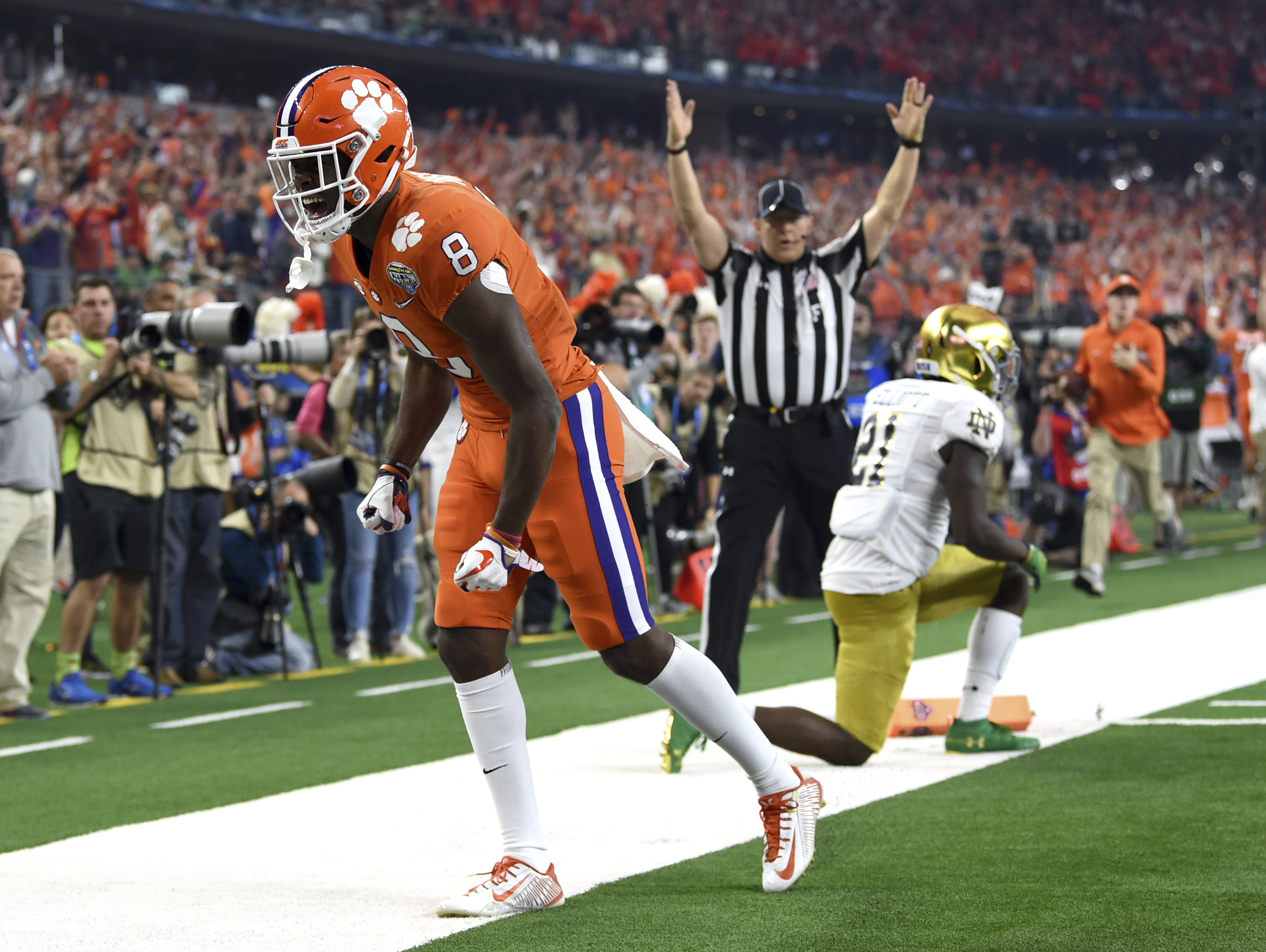Clemson wide receiver Justyn Ross (8) celebrates his touchdown catch in front of Notre Dame safety Jalen Elliott (21) in the first half of the NCAA Cotton Bowl semi-final playoff football game, Saturday, Dec. 29, 2018, in Arlington, Texas. (AP Photo/Jeffrey McWhorter)