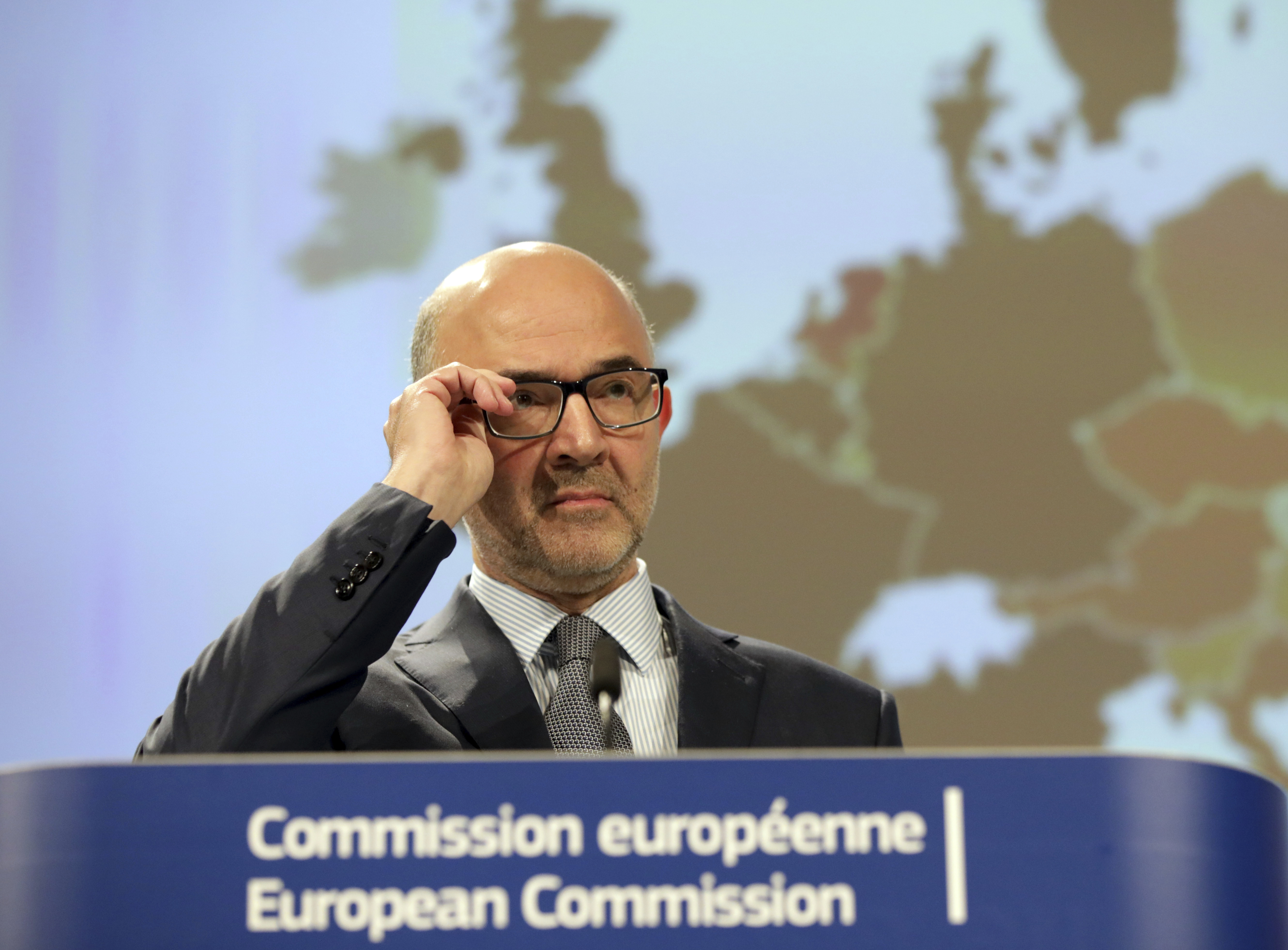 European Commissioner for Economic and Financial Affairs Pierre Moscovici pauses before speaking as he presents the Autumn 2018 economic forecast at EU headquarters in Brussels, Thursday, Nov. 8, 2018. (AP Photo/Olivier Matthys)