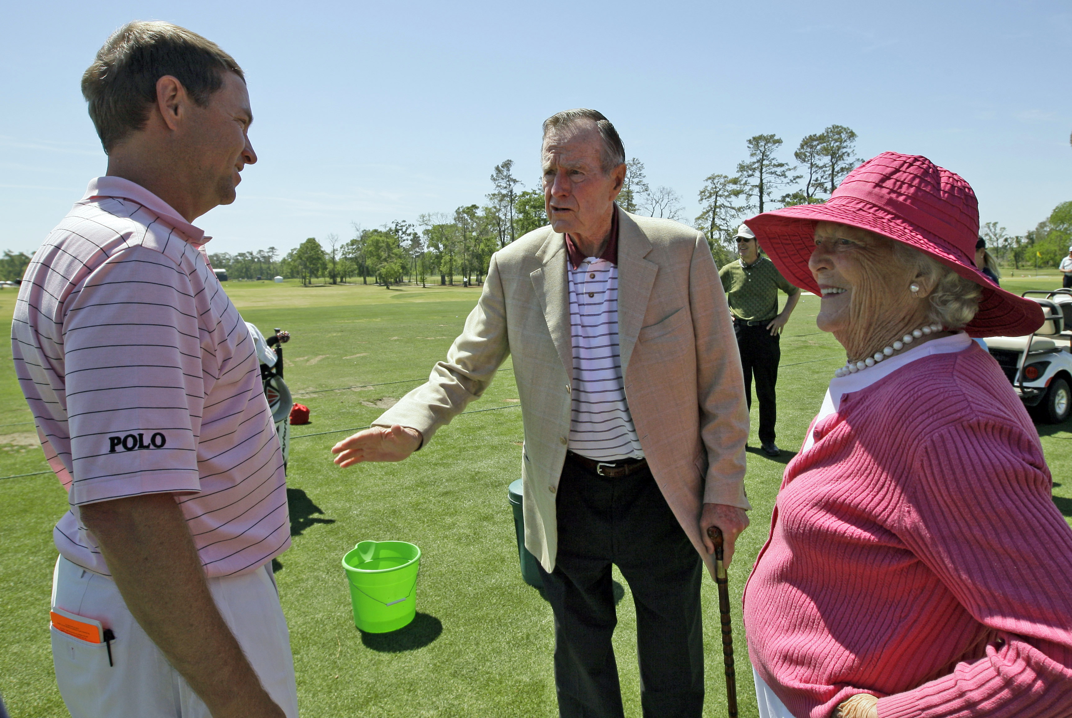 FILE - In this April 3, 2009, file photo, Former President George H.W. Bush, center, and his wife Barbara, right, talk with Davis Love III on the practice range during the first round of the Houston Open golf tournament in Humble, Texas. Love is among several players Bush used to invited to Maine for golf. Bush died Friday, Nov. 30, 2018. (AP Photo/David J. Phillip, File)