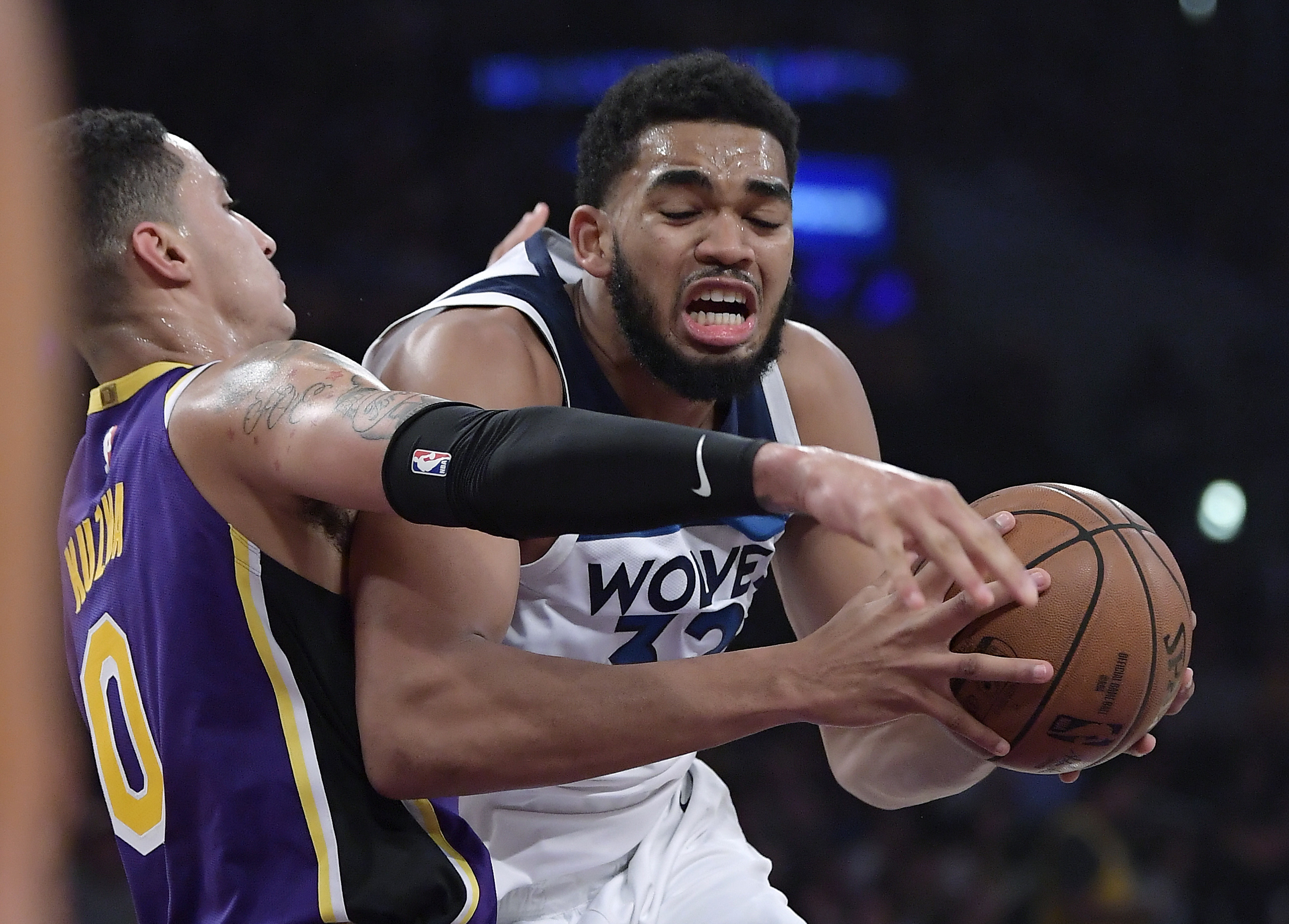 Minnesota Timberwolves center Karl-Anthony Towns, right, tries to get past Los Angeles Lakers forward Kyle Kuzma during the first half of an NBA basketball game Wednesday, Nov. 7, 2018, in Los Angeles. (AP Photo/Mark J. Terrill)