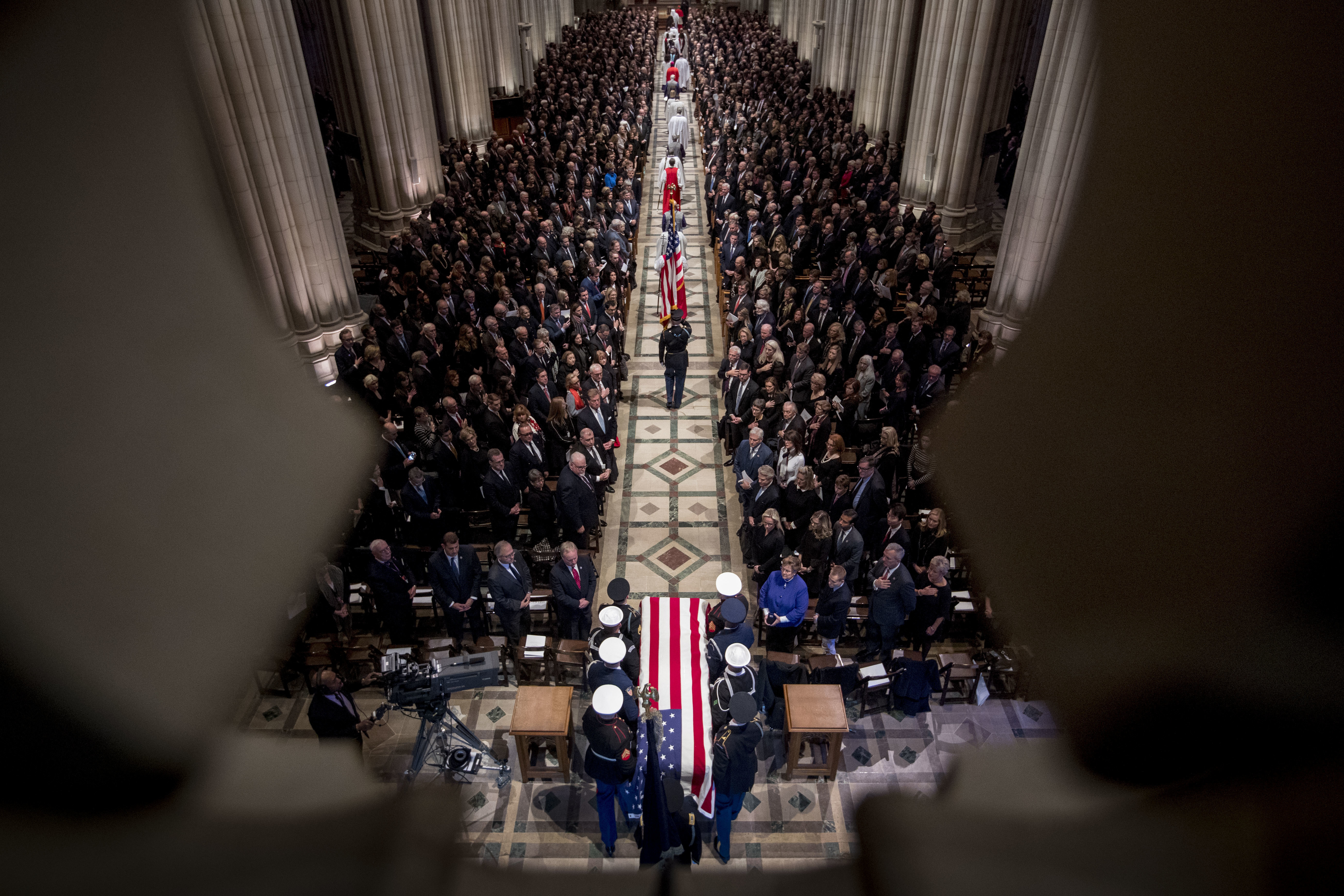 The flag-draped casket of former President George H.W. Bush is carried by a military honor guard during a State Funeral at the National Cathedral, Wednesday, Dec. 5, 2018, in Washington. (AP Photo/Andrew Harnik, Pool)