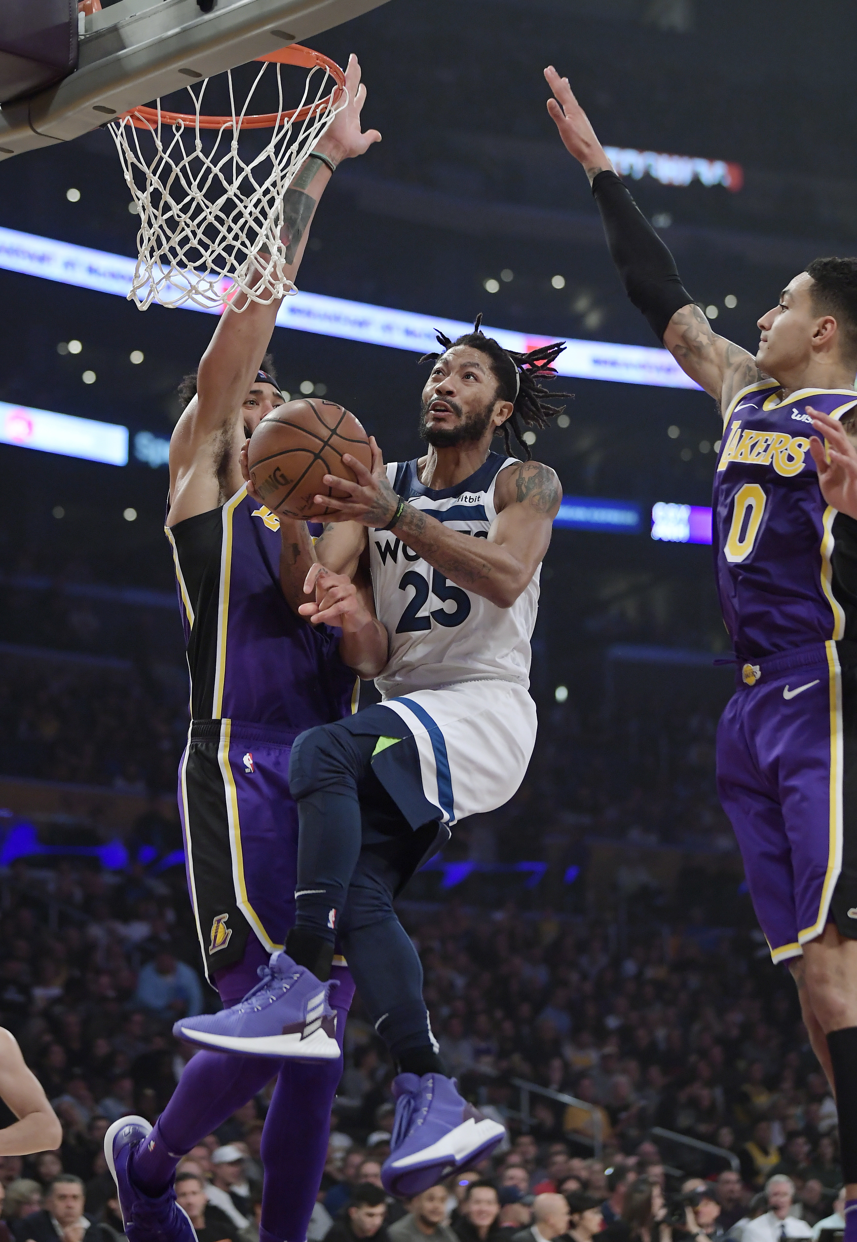 Minnesota Timberwolves guard Derrick Rose, center, goes to the basket as Los Angeles Lakers center JaVale McGee, left, and forward Kyle Kuzma defend during the first half of an NBA basketball game Wednesday, Nov. 7, 2018, in Los Angeles. (AP Photo/Mark J. Terrill)