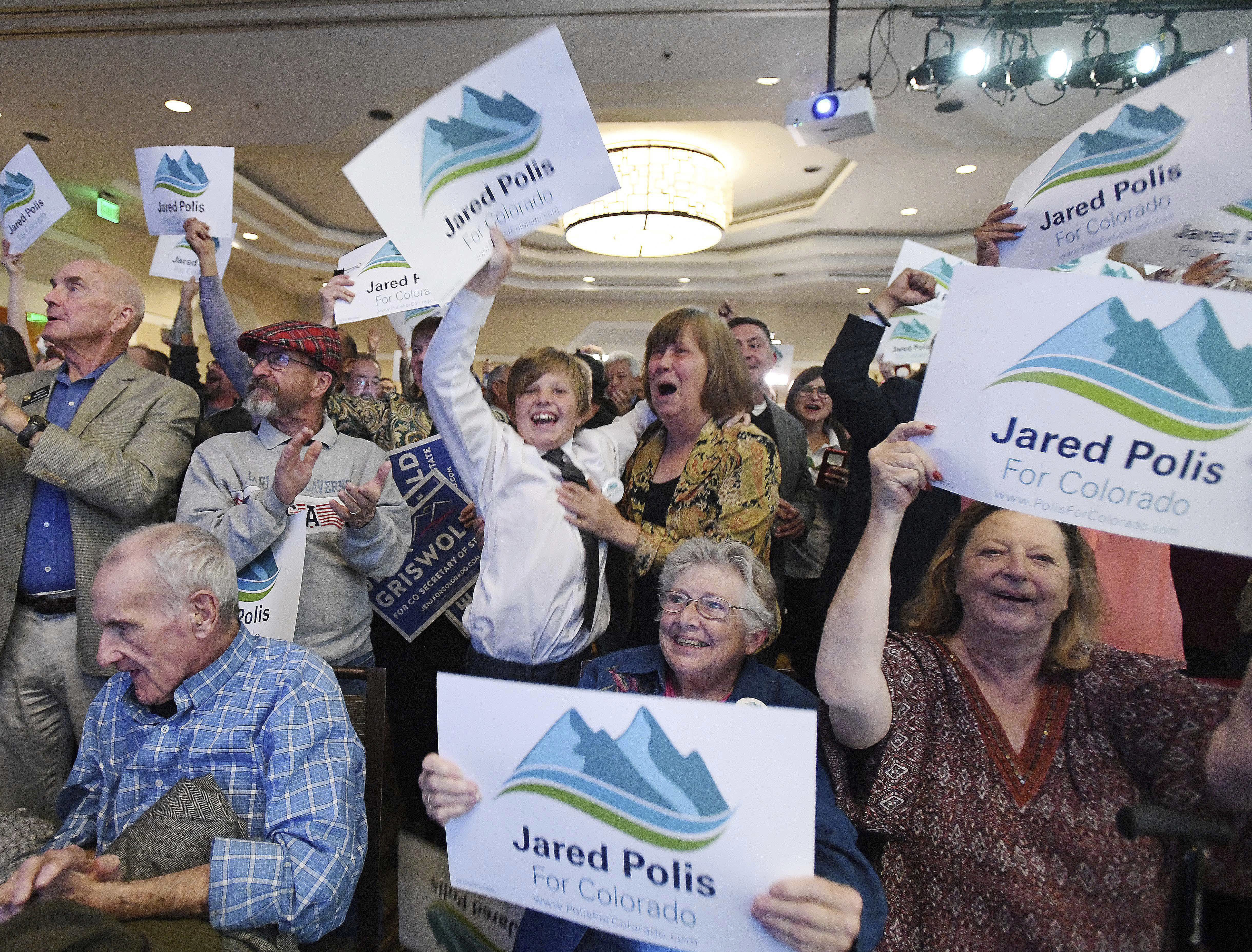 Democrats erupt when the Colorado Governor race is called for gubernatorial candidate Jared Polis at the Democratic watch party at the Westin Hotel in downtown Denver, Tuesday, Nov. 6, 2018. (Jerilee Bennett/The Gazette via AP)
