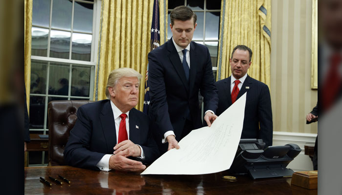 Rob Porter - Shown, center, alongside President Donald Trump and then-Chief of Staff Reince Priebus in this 2017 file photo, Porter announced his resignation Feb. 7 amid domestic violence allegations from his ex-wives. (AP Photo/Evan Vucci)