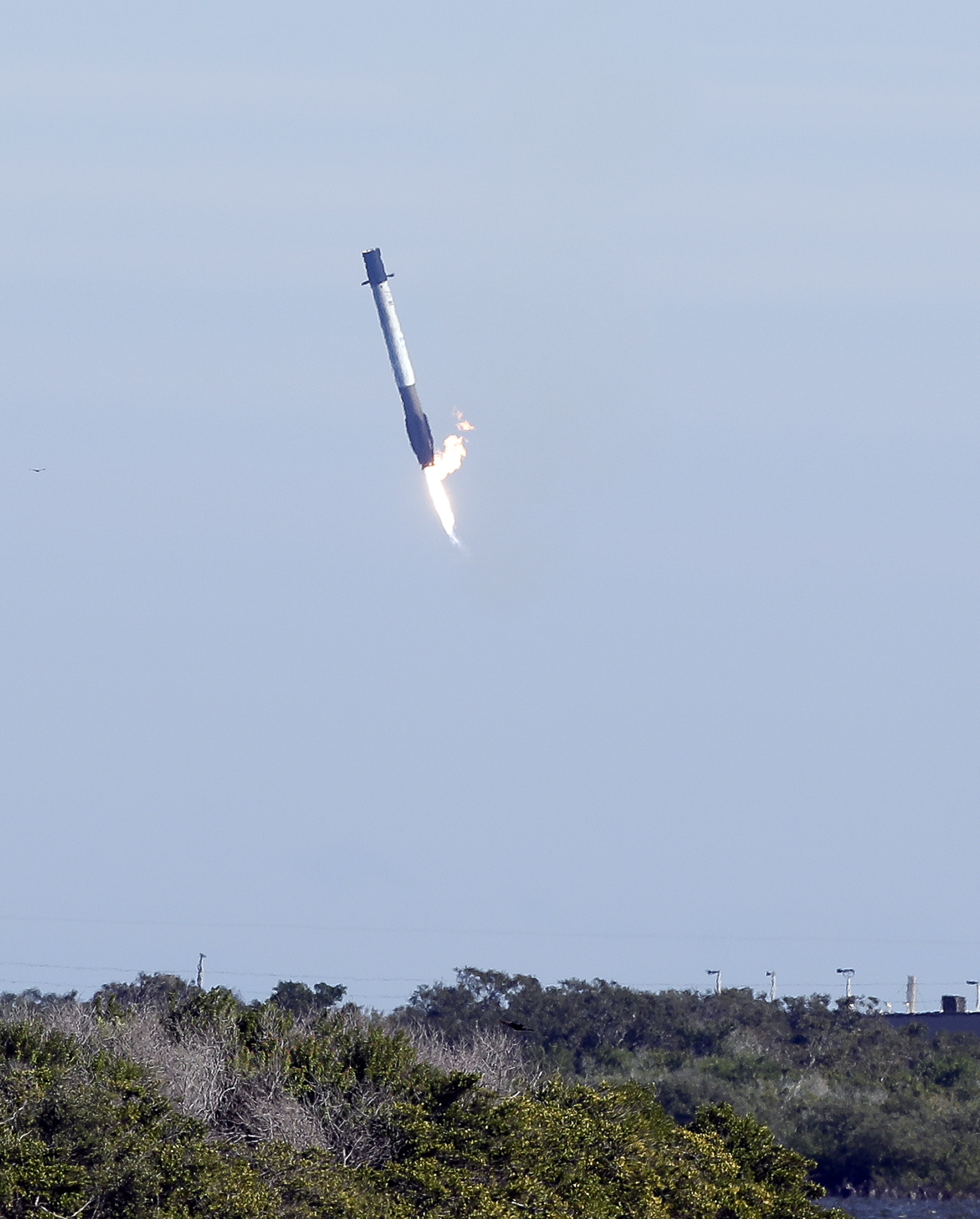 The first stage booster from a Falcon 9 rocket experiences a control problem during its descent, landing in the Atlantic Ocean just east of the launch site instead of a landing zone at the Cape Canaveral Air Force Station in Cape Canaveral, Fla., Wednesday, Dec. 5, 2018. (AP Photo/John Raoux)