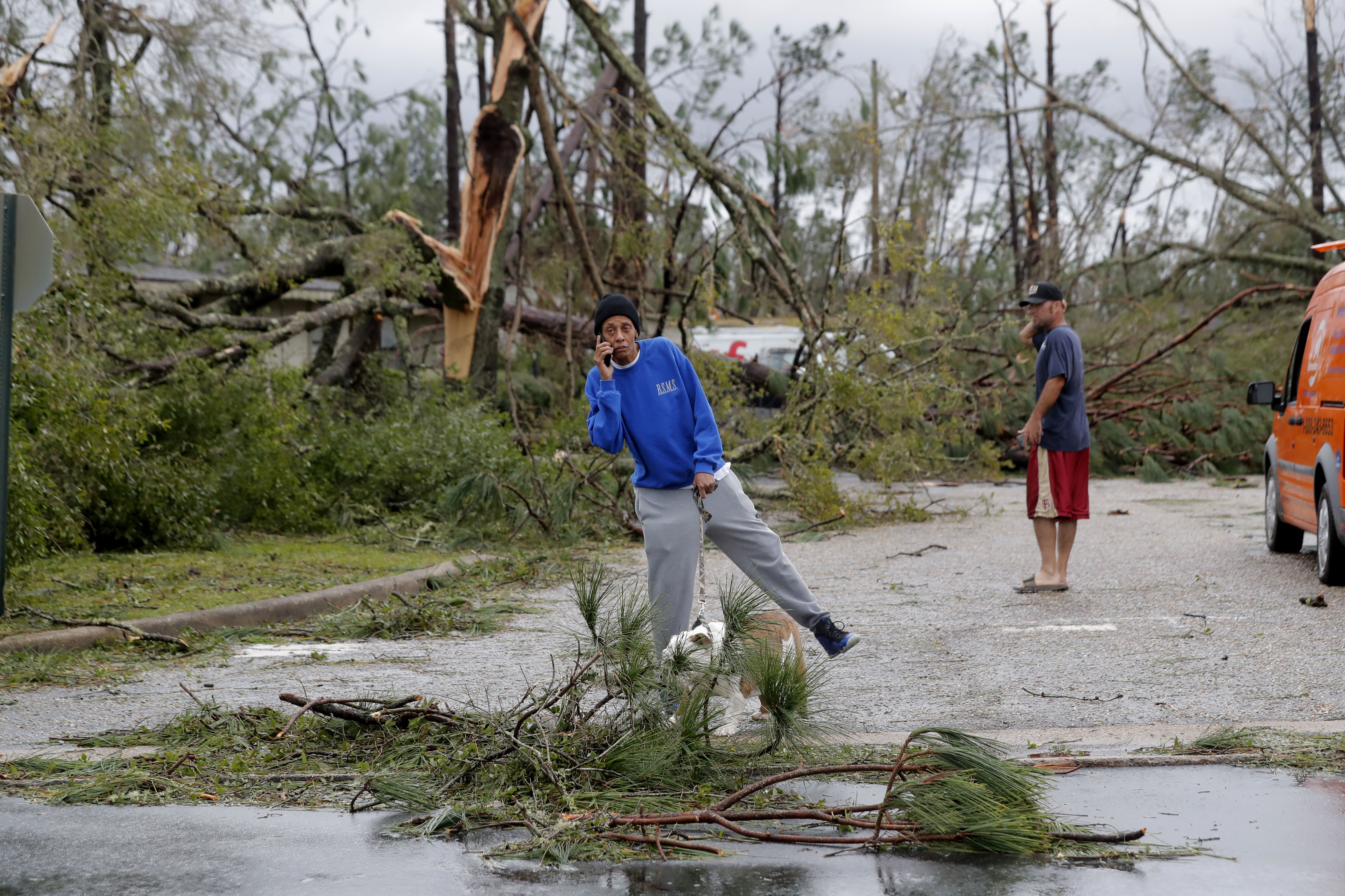 Pam Heckstall surveys the damage as the remnants of Hurricane Michael move through Panama City, Fla., Wednesday, Oct. 10, 2018. She is not able to leave her street due to downed trees. (AP Photo/Gerald Herbert)
