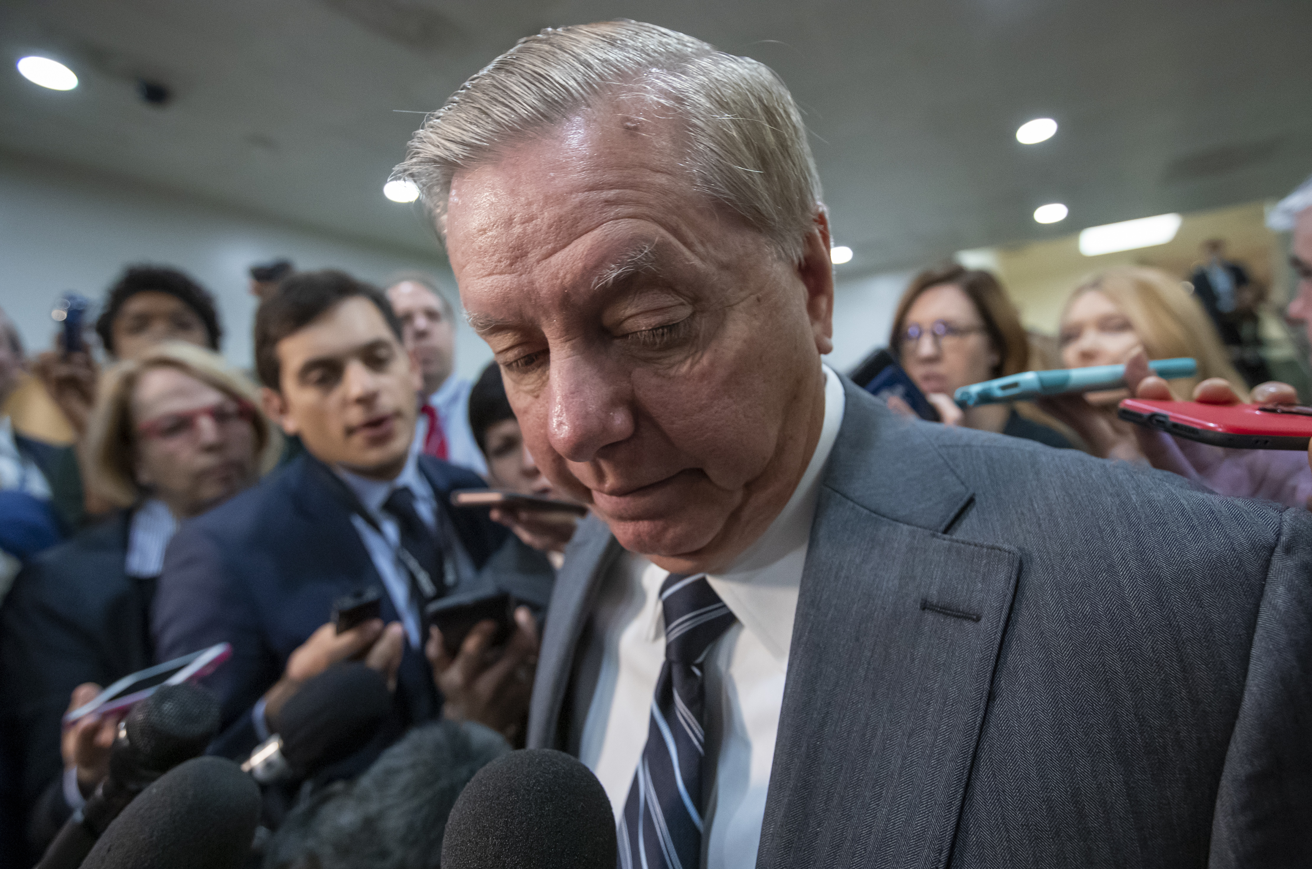 Sen. Lindsey Graham, R-S.C., chairman of the Subcommittee on Crime and Terrorism, pauses as he speaks to reporters after a closed-door security briefing by CIA Director Gina Haspel on the slaying of Saudi journalist Jamal Khashoggi and involvement of the Saudi crown prince, Mohammed bin Salman, at the Capitol in Washington, Tuesday, Dec. 4, 2018. Graham said there is