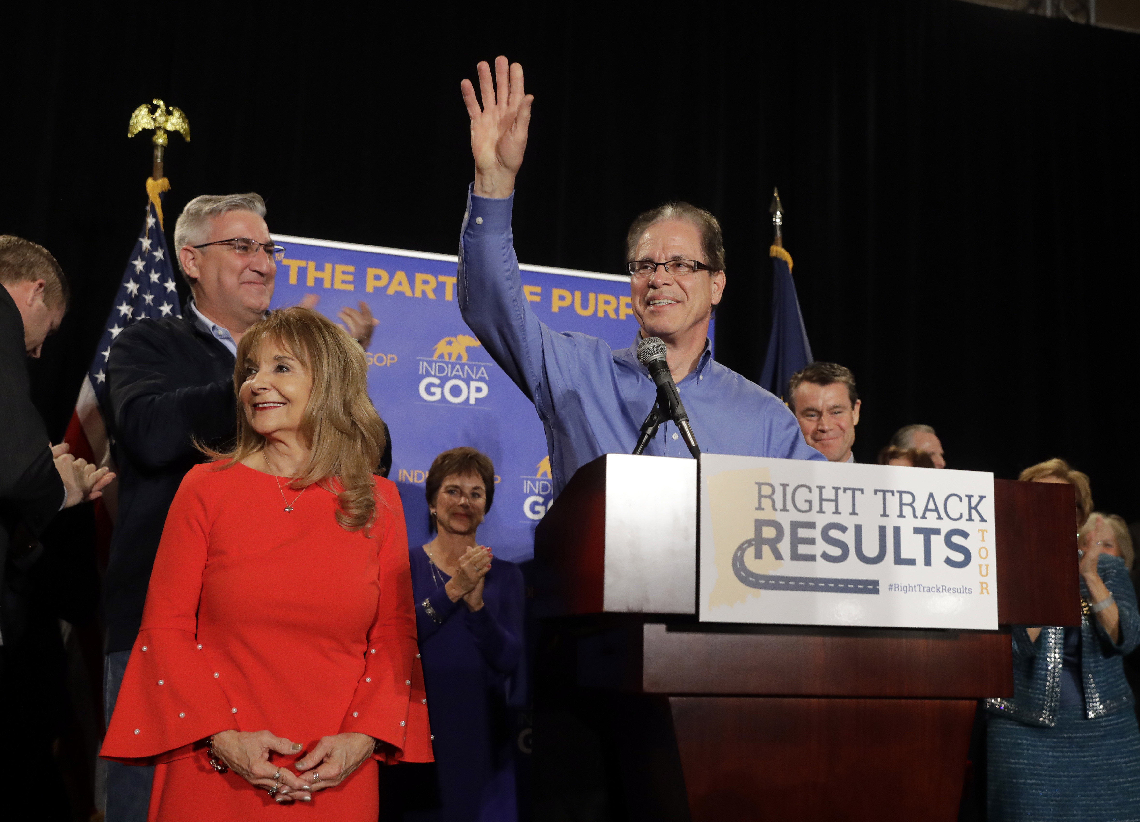 Republican Mike Braun celebrates with his wife, Maureen, during an election night party, Tuesday, Nov. 6, 2018, in Indianapolis. Braun defeated Sen. Joe Donnelly, D-Ind. (AP Photo/Darron Cummings)