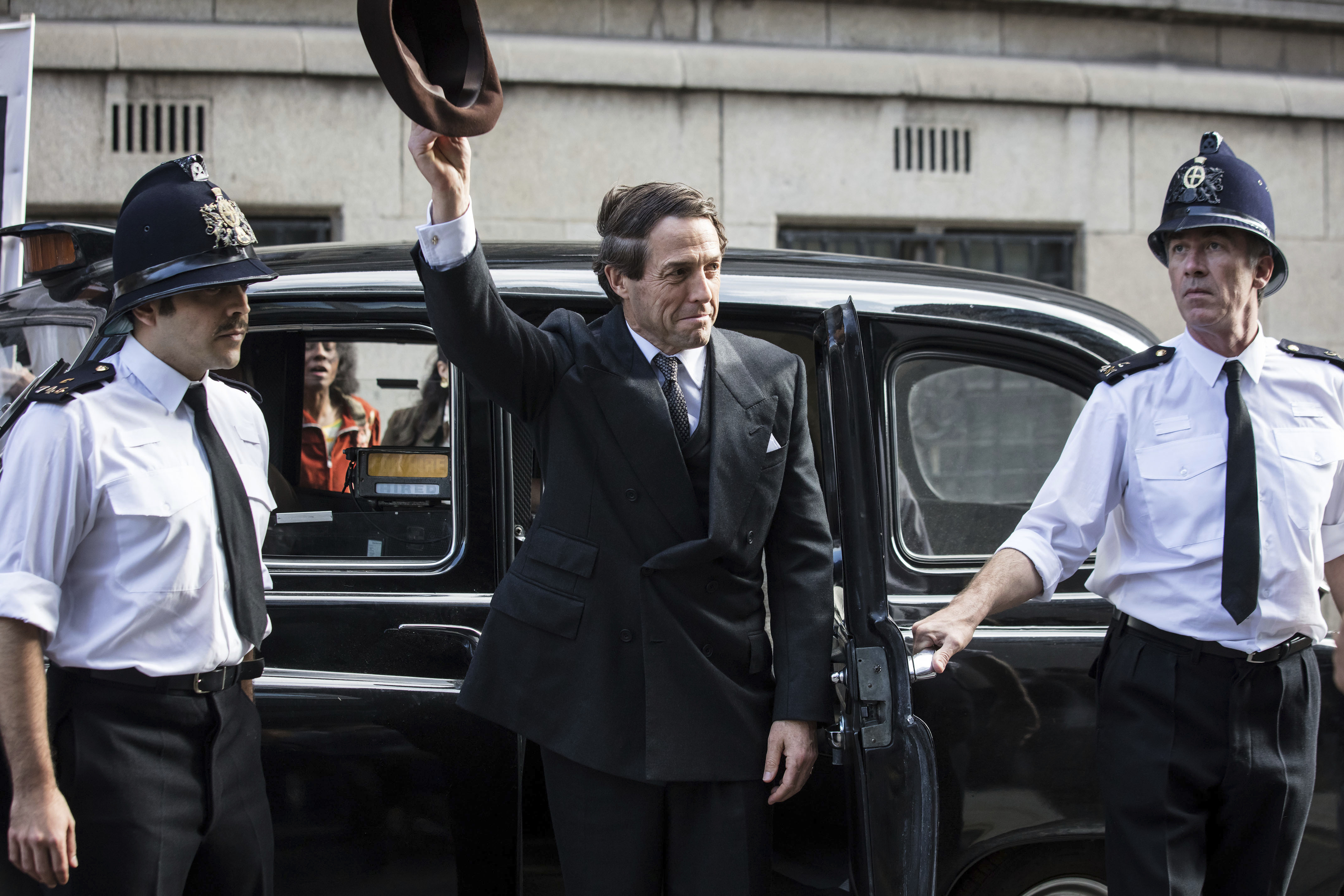 This image released by Amazon shows Hugh Grant in a scene from