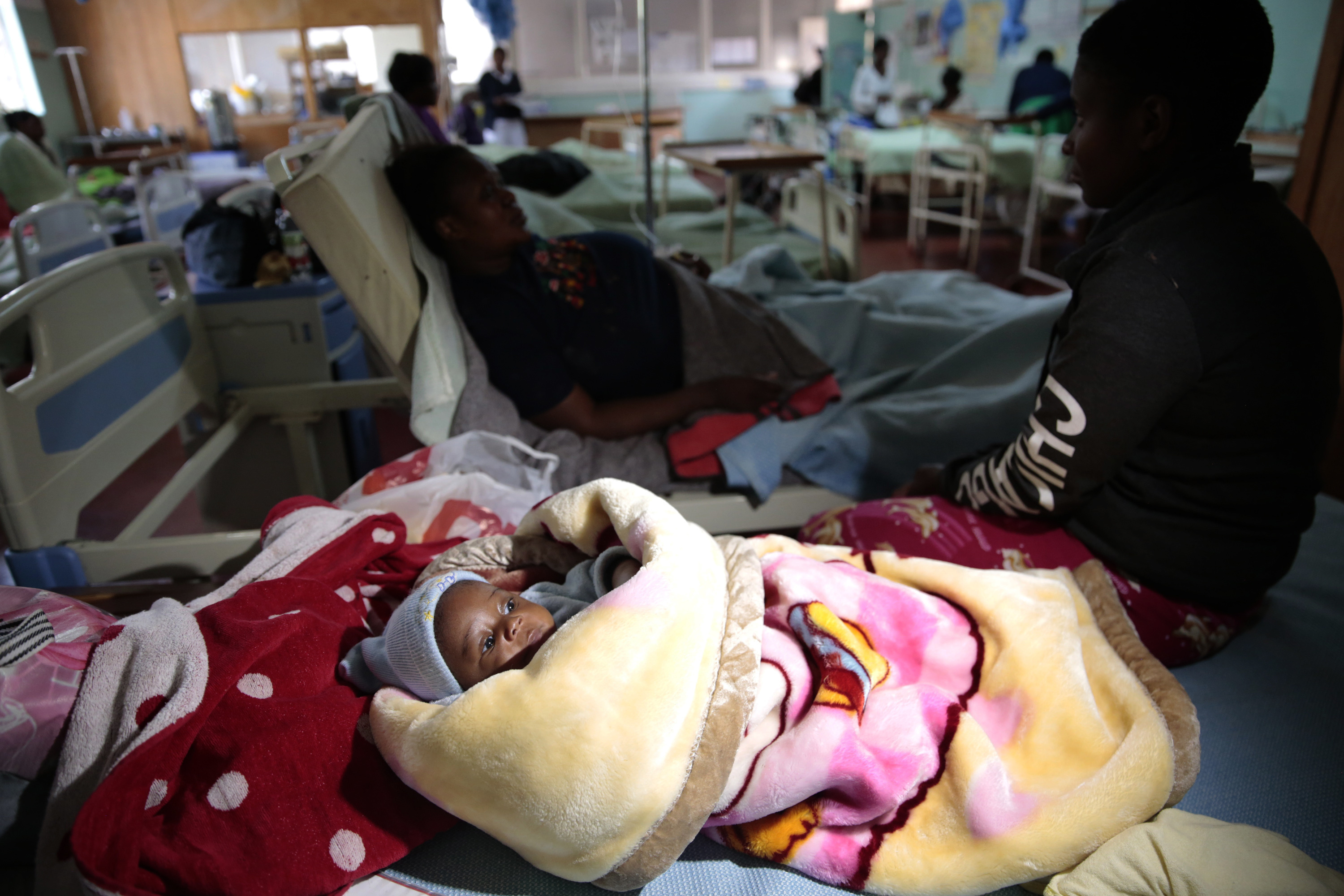 Klavan Munyisa who is 3 months old lays in a hospital bed after surviving a bus crash in Rusape about 170 kilometres east of the capital Harare, Thursday, Nov. 8, 2018. A head-on collision between two buses has killed 47 people, where road accidents are common due to poor roads and bad driving. (AP Photo/Tsvangirayi Mukwazhi)