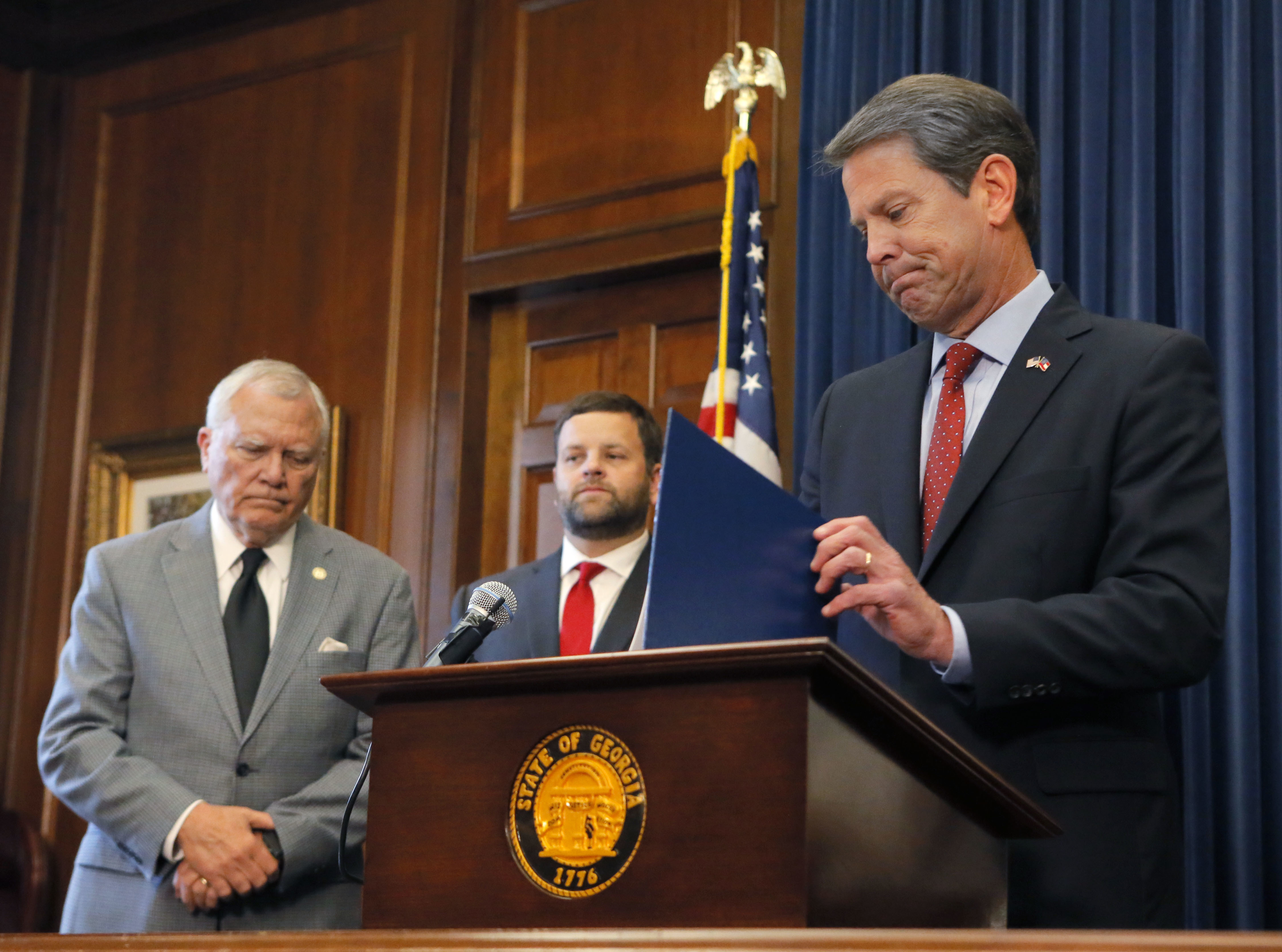 Republican Brian Kemp, right, holds a news conference with Georgia Gov. Nathan Deal, left, in the Governor's ceremonial office at the Capitol on Thursday, Nov. 8, 2018, in Atlanta, Ga. Kemp resigned Thursday as Georgia's secretary of state, a day after his campaign said he's captured enough votes to become governor despite his rival's refusal to concede. (Bob Andres/Atlanta Journal-Constitution via AP)