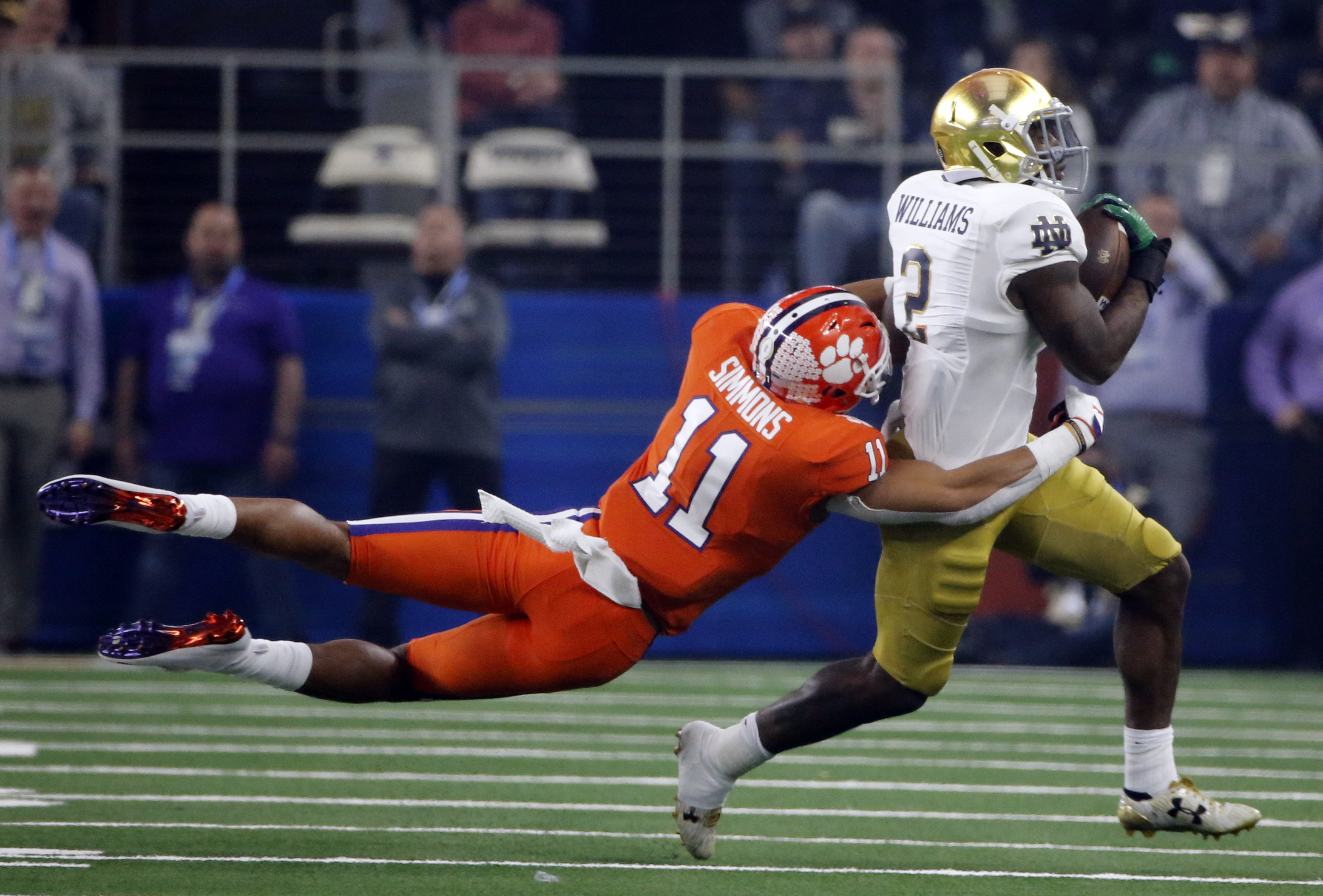 Clemson safety Isaiah Simmons (11) attempts to stop Notre Dame running back Dexter Williams (2) from gaining more yardage in the first half of the NCAA Cotton Bowl semi-final playoff football game, Saturday, Dec. 29, 2018, in Arlington, Texas. (AP Photo/Michael Ainsworth)
