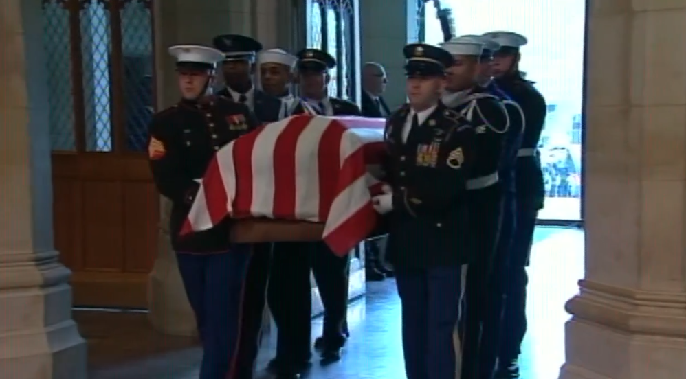 Military pallbearers carrying remains of President George H. W. Bush into the National Cathedral