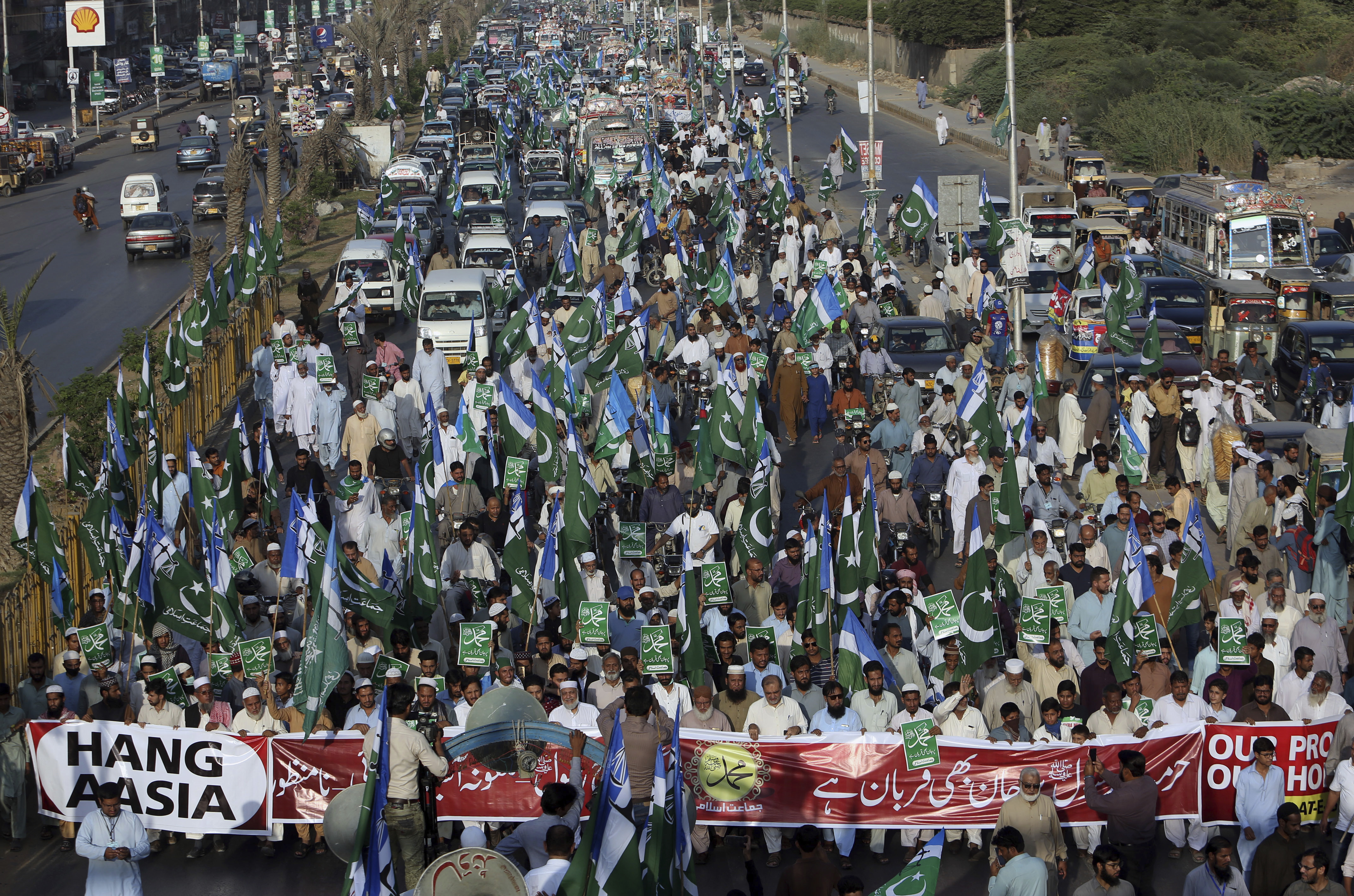 FILE - In this Nov. 4, 2018, file photo, supporters of Jamaat-i-Islami, a Pakistani Islamist party, participate in a rally to condemn a Supreme Court decision that acquitted a Christian woman, in Karachi, Pakistan. Aasia Bibi, Christian woman acquitted after eight years on death row for blasphemy was released but her whereabouts in Islamabad on Thursday remained a closely guarded secret in the wake of demands by radical Islamists that she be publicly executed. (AP Photo/Fareed Khan)