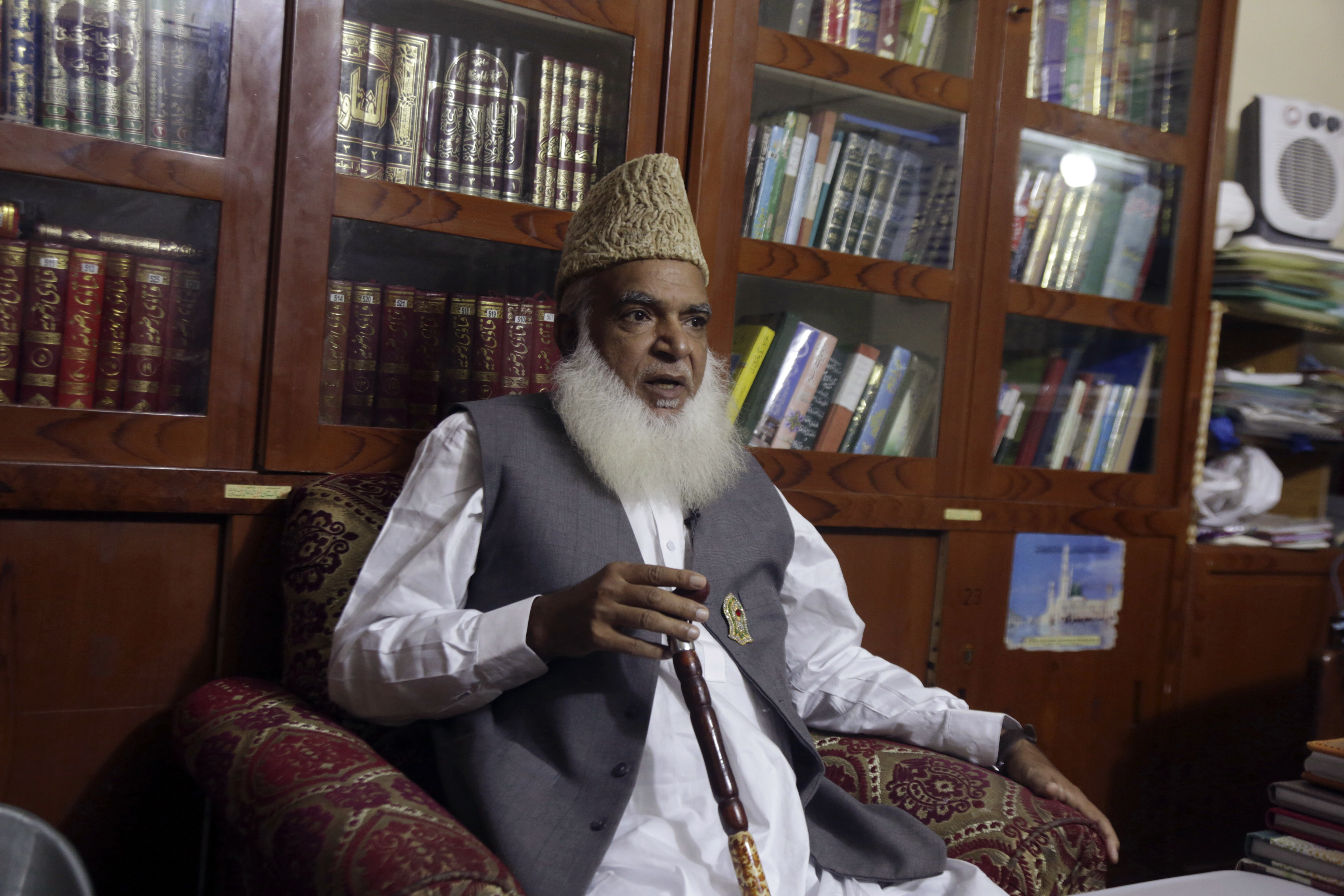 In this Tuesday, Nov. 6, 2018, photo, Pakistani cleric Muhammad Afzal Qadri, leader in the Tehreek-e-Labbaik Party talks about Christian woman Asia Bibi, in Gujrat, Pakistan. The Christian woman acquitted after eight years on death row for blasphemy was released but her whereabouts in Islamabad on Thursday, Nov. 8 remained a closely guarded secret in the wake of demands by radical Islamists that she be publicly executed. Following her acquittal, the hard-line Tehreek-e-Labbaik Party forced a country-wide shut down as their supporters took to the streets for three days to protest Bibi's release. (AP Photo/K.M. Chaudary)