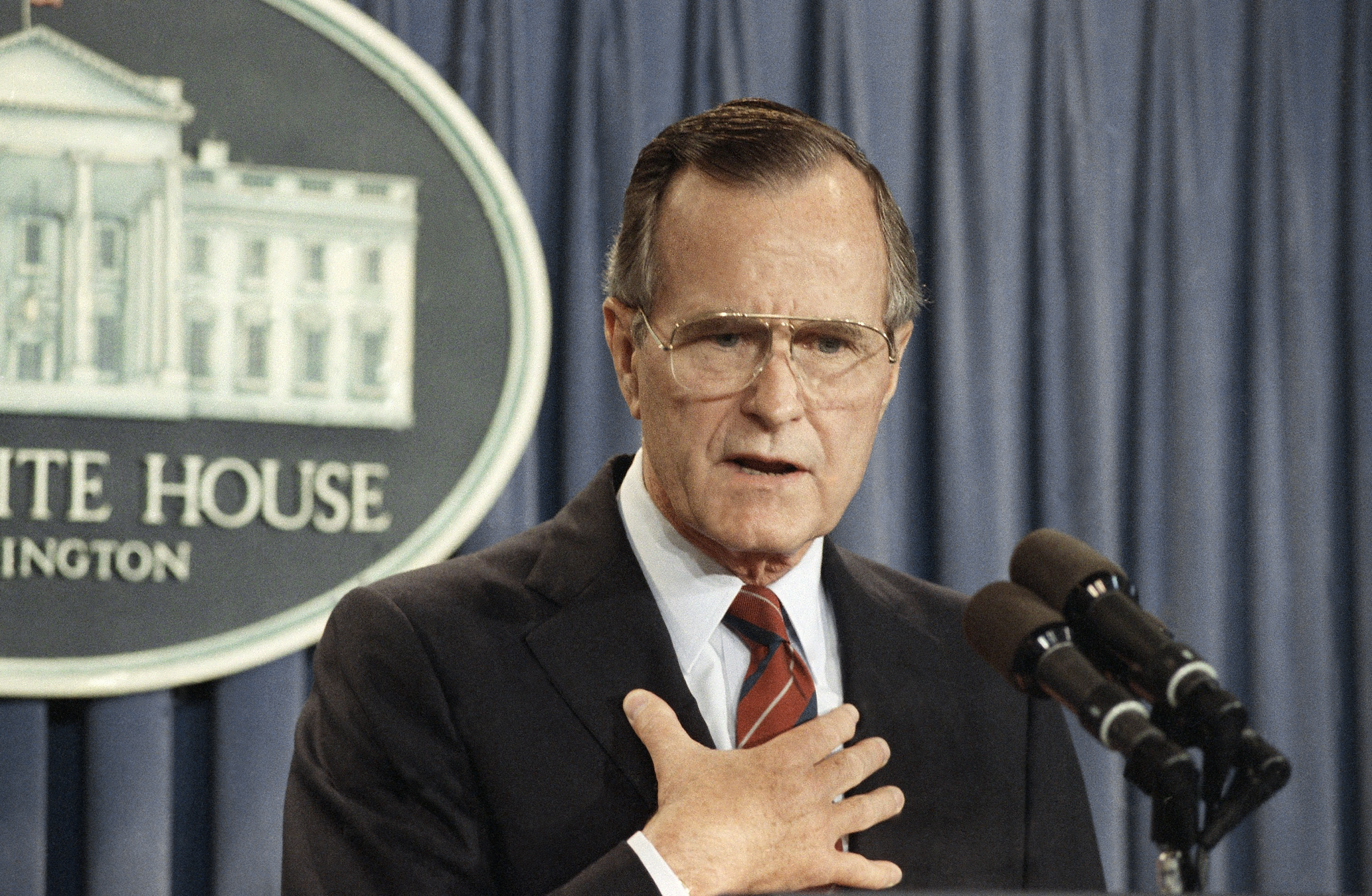Pres. George H. W. Bush, appearing at a news conference at the White House, tells reporters that he will propose a constitutional amendment to forbid the desecration of the American flag, June 27, 1989, in Washington, D.C., after the Supreme Court ruled it was within 1st amendment rights to burn the flag. (AP Photo/Barry Thumma)