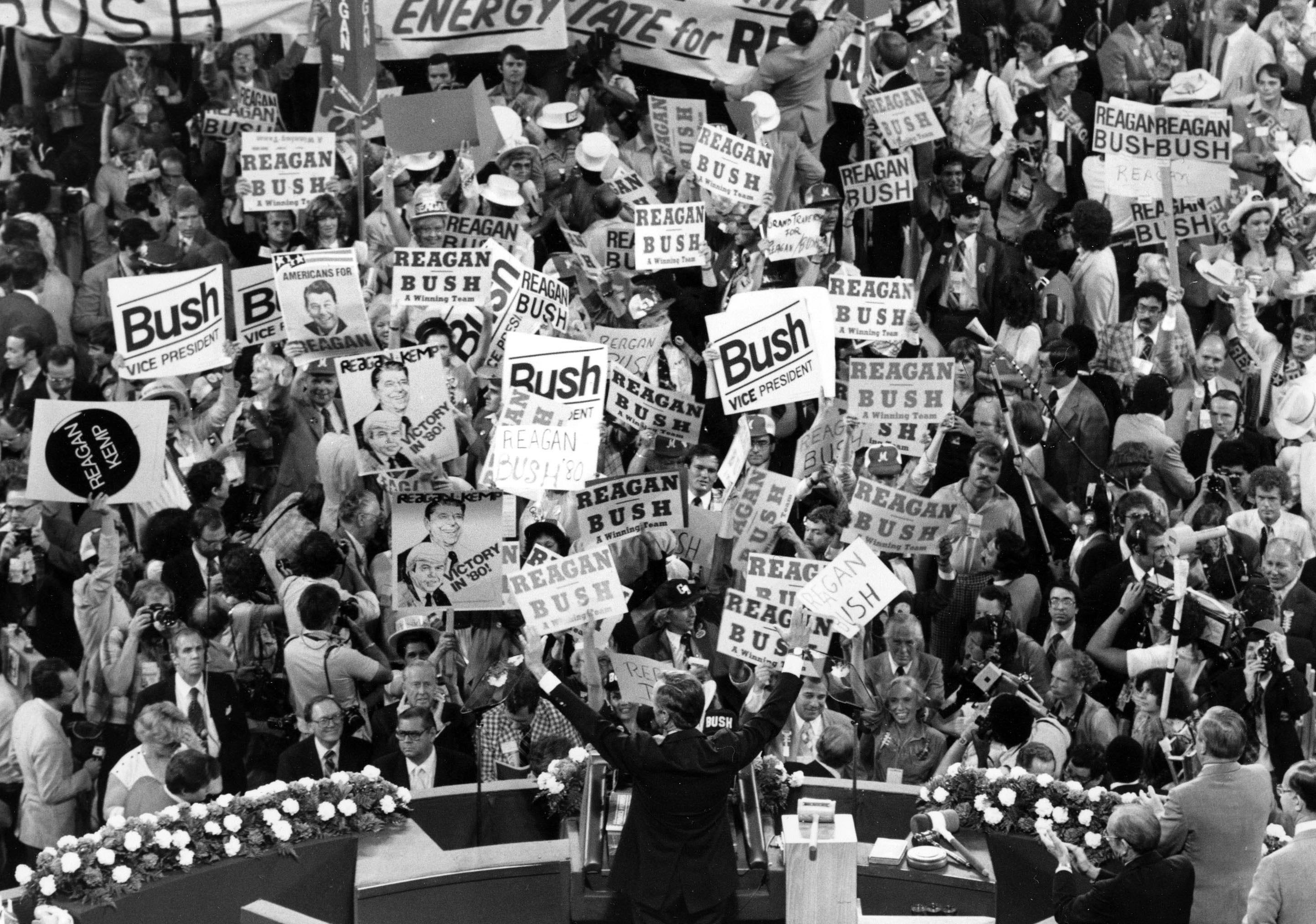 In this July 16, 1980 photo George H.W. Bush, center foreground, acknowledges the crowd before speaking to the Republican Convention delegates in Detroit, MI. (AP Photo/File)