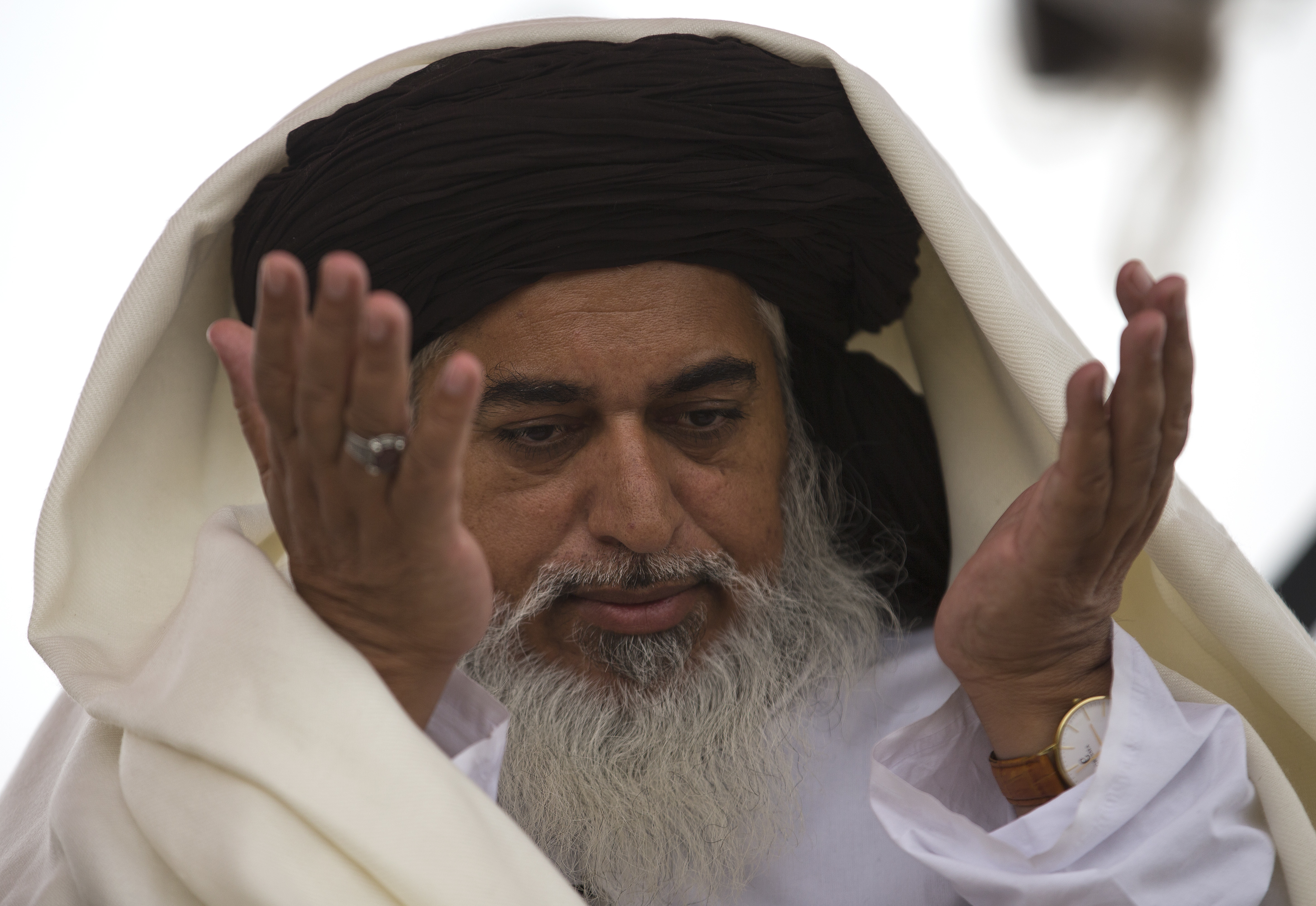 FILE - In this Nov. 24, 2017 file photo, the head of the Pakistani Tehreek-e-Labbaik radical religious party, Khadim Hussain Rizvi prays during a sit-in protest in Islamabad, Pakistan. The party of a radical Islamic cleric who disrupted daily life with rallies across Pakistan following the acquittal of a Christian woman in a blasphemy case says he has been arrested Friday, Nov. 23, 2018 by police in the city of Lahore. (AP Photo/B.K. Bangash, file)