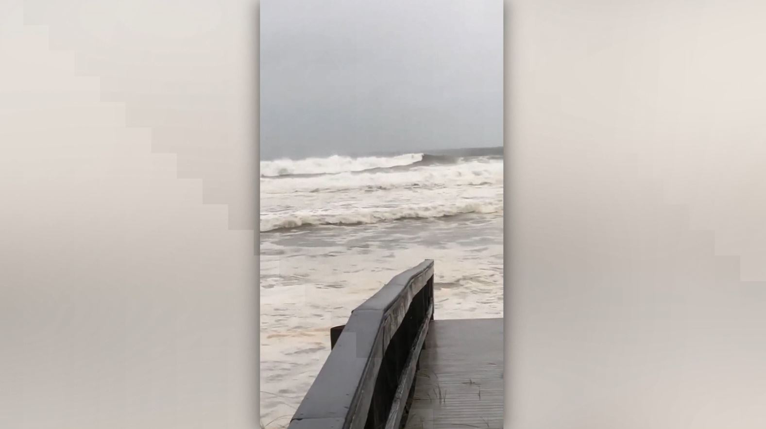 The waves in Destin reach to the beach walkway Wednesday morning before the powerful Hurricane Michael made landfall along the Florida Panhandle.