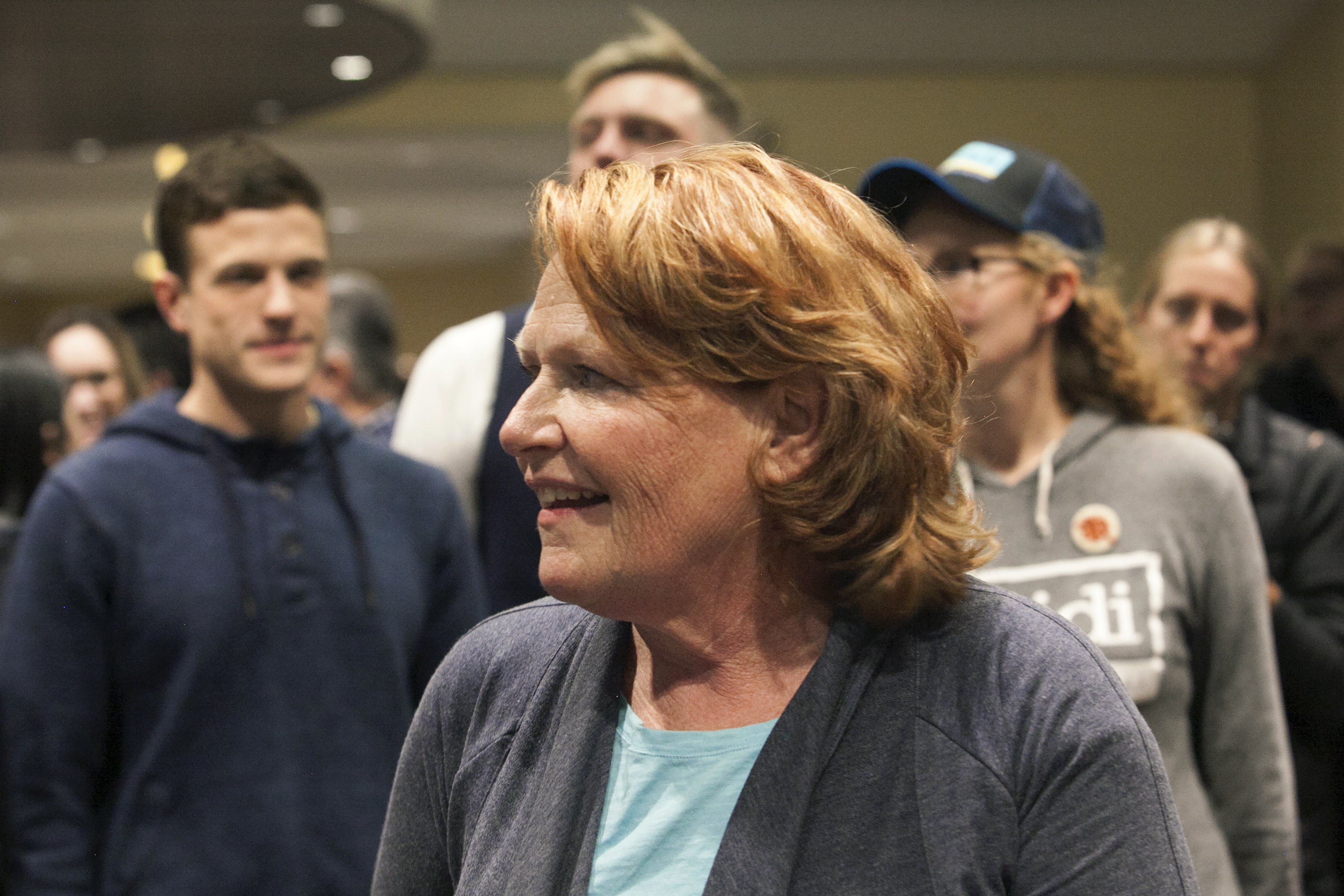 Well-wishers surround Sen. Heidi Heitkamp, D-N.D., after she addressed supporters at an election night watch party on Tuesday, Nov. 6, 2018, in West Fargo, N.D. Republican Rep. Kevin Cramer defeated Heitkamp. (AP Photo/Ann Arbor Miller)