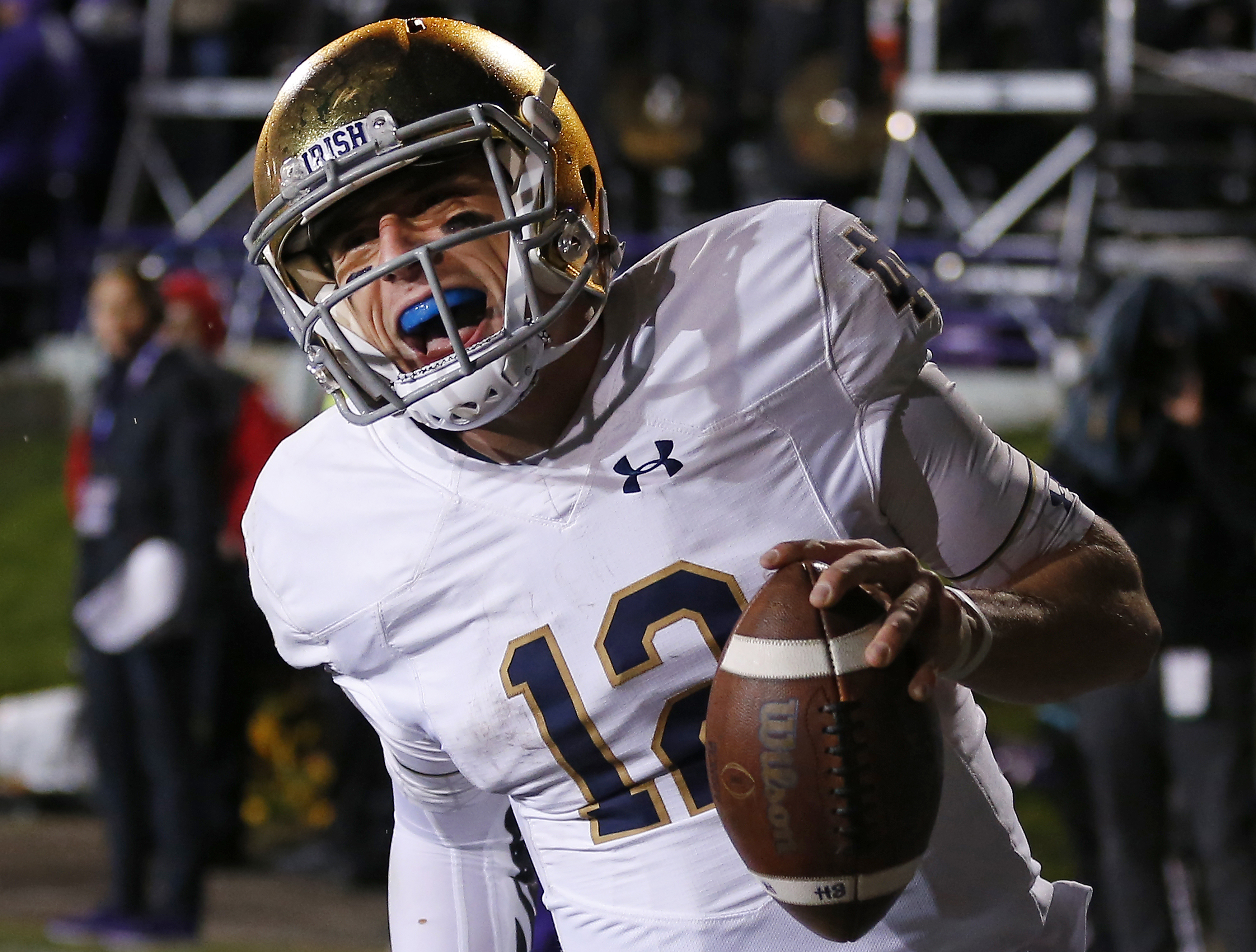 FILE - In this Saturday, Nov. 3, 2018, file photo, Notre Dame's Ian Book celebrates as he scores a touchdown against Northwestern during the second half of an NCAA college football game in Evanston, Ill. Third-ranked Notre Dame will put its unbeaten record on the line when it faces No. 12 Syracuse at New York's Yankee Stadium on Saturday. (AP Photo/Jim Young, File)
