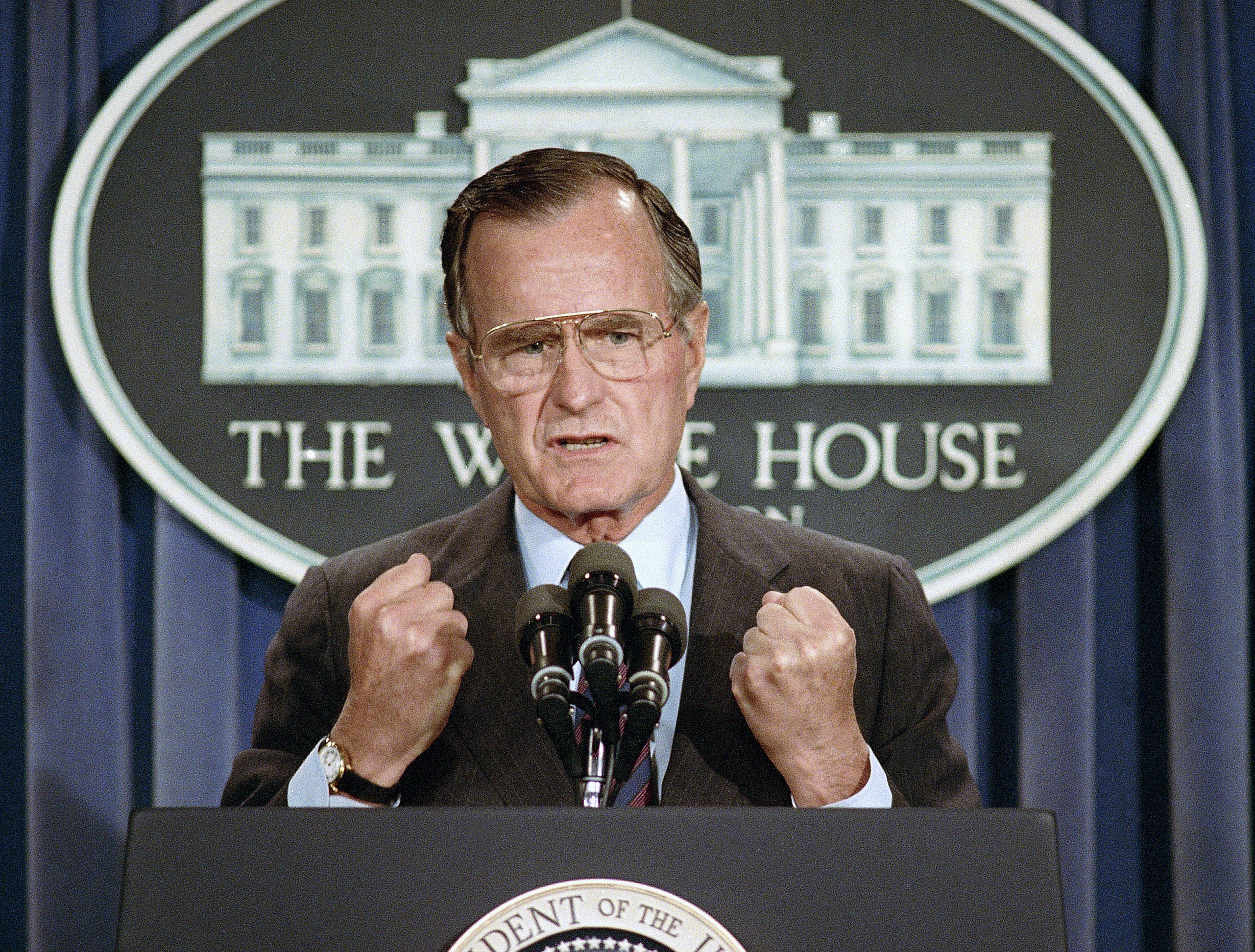 In this June 5, 1989, photo, U.S. President George H.W. Bush holds a news conference at the White House in Washington where he condemned the Chinese crackdown on pro-democracy demonstrators in Beijing's Tiananmen Square. (AP Photo/Marcy Nighswander, File)