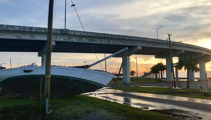 A sailboat was thrown onto dry land by Hurricane Michael's huge waves and storm surge in Apalachicola, FL. (Source: CNN)