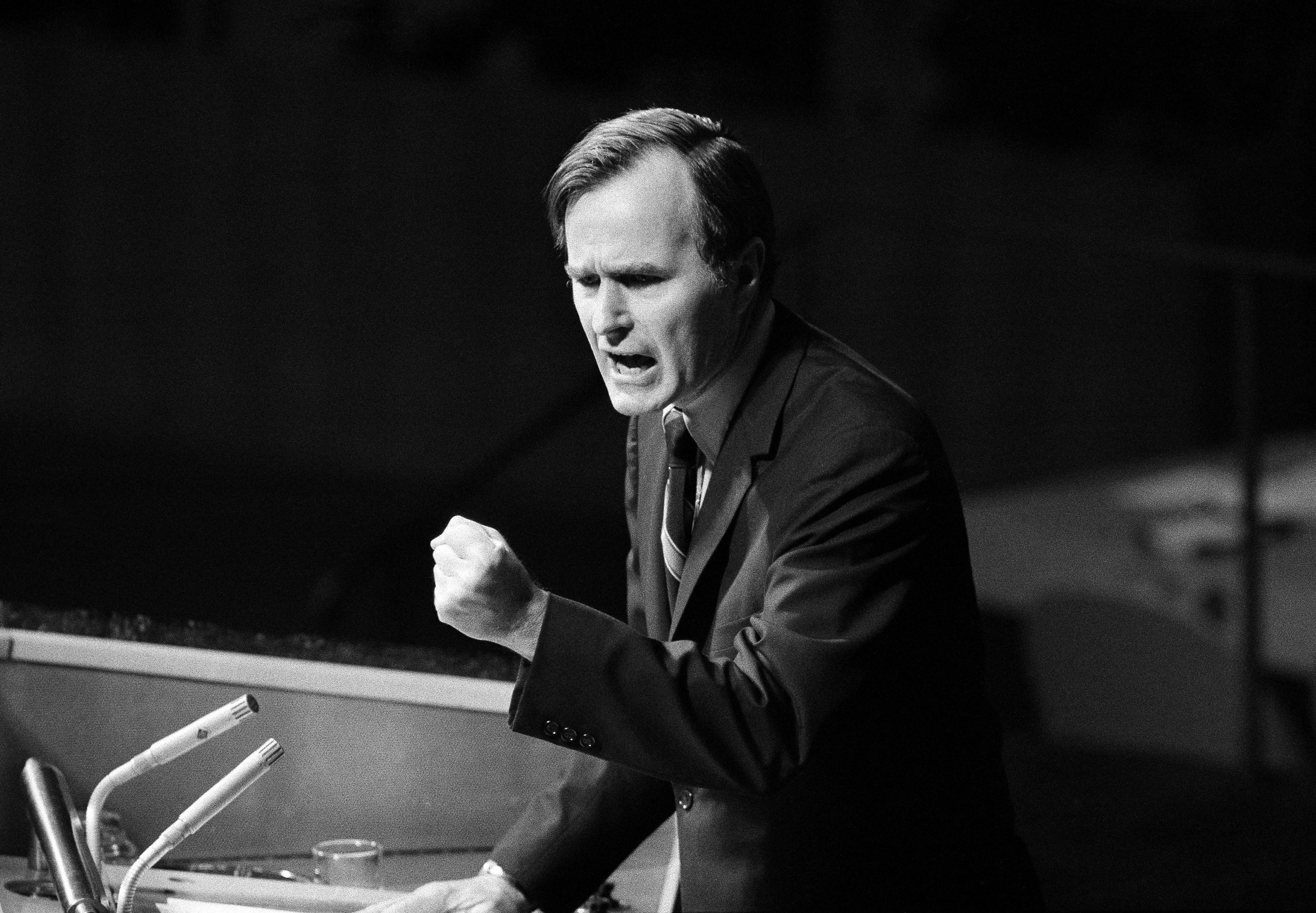 In this Oct. 18, 1971, photo, U.S. Ambassador George H.W. Bush gestures as he addresses the United Nations General Assembly during the China debate. He denied the U.S. formula was either a