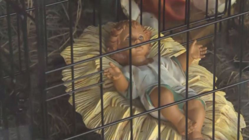 In the scene, baby Jesus can be seen in a cage, which the church says is meant to represent migrant children held at the southern border and separated from their parents.