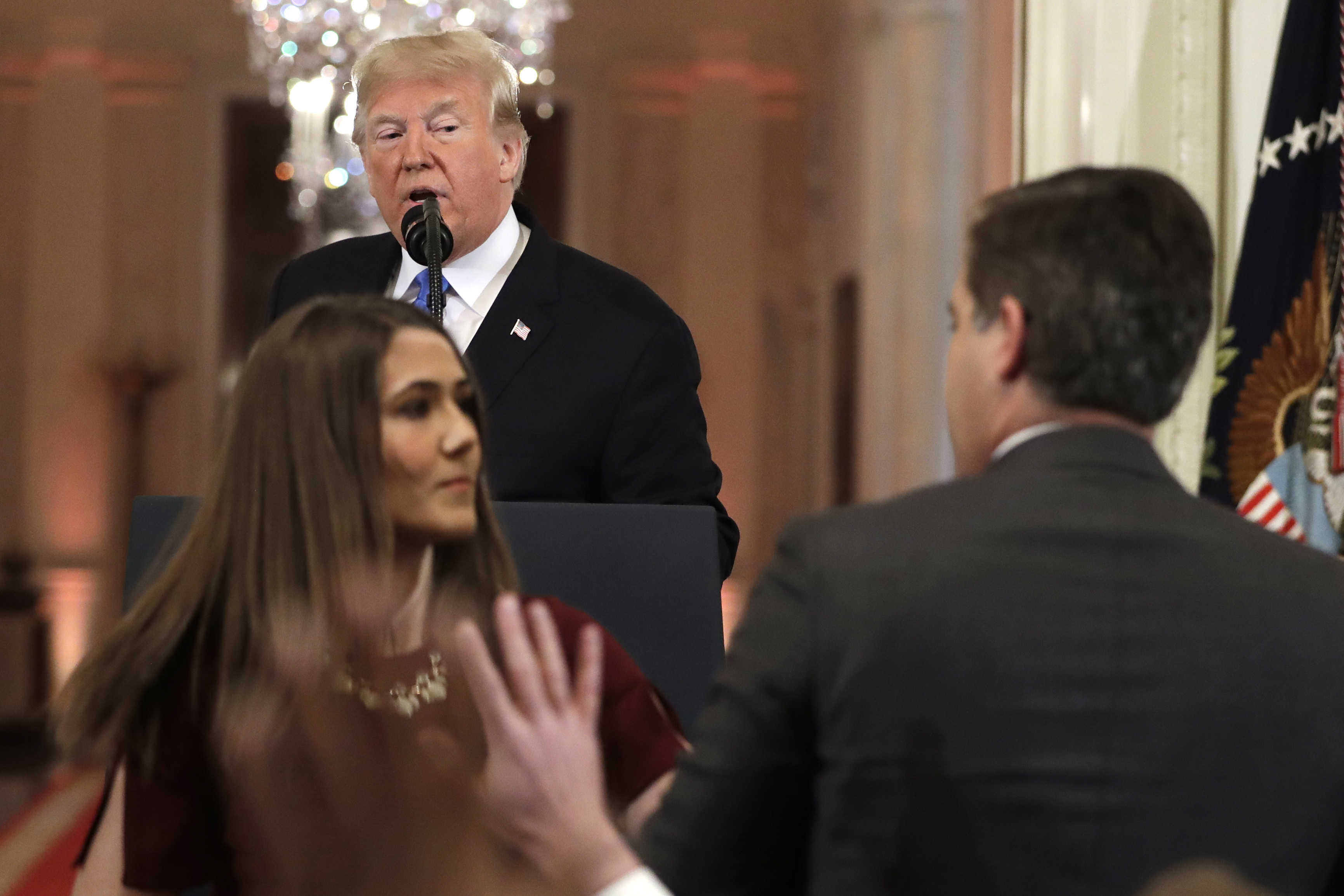 As President Donald Trump watches, a White House aide takes the microphone from CNN's Jim Acosta, during a news conference in the East Room of the White House, Wednesday, Nov. 7, 2018, in Washington. (AP Photo/Evan Vucci)