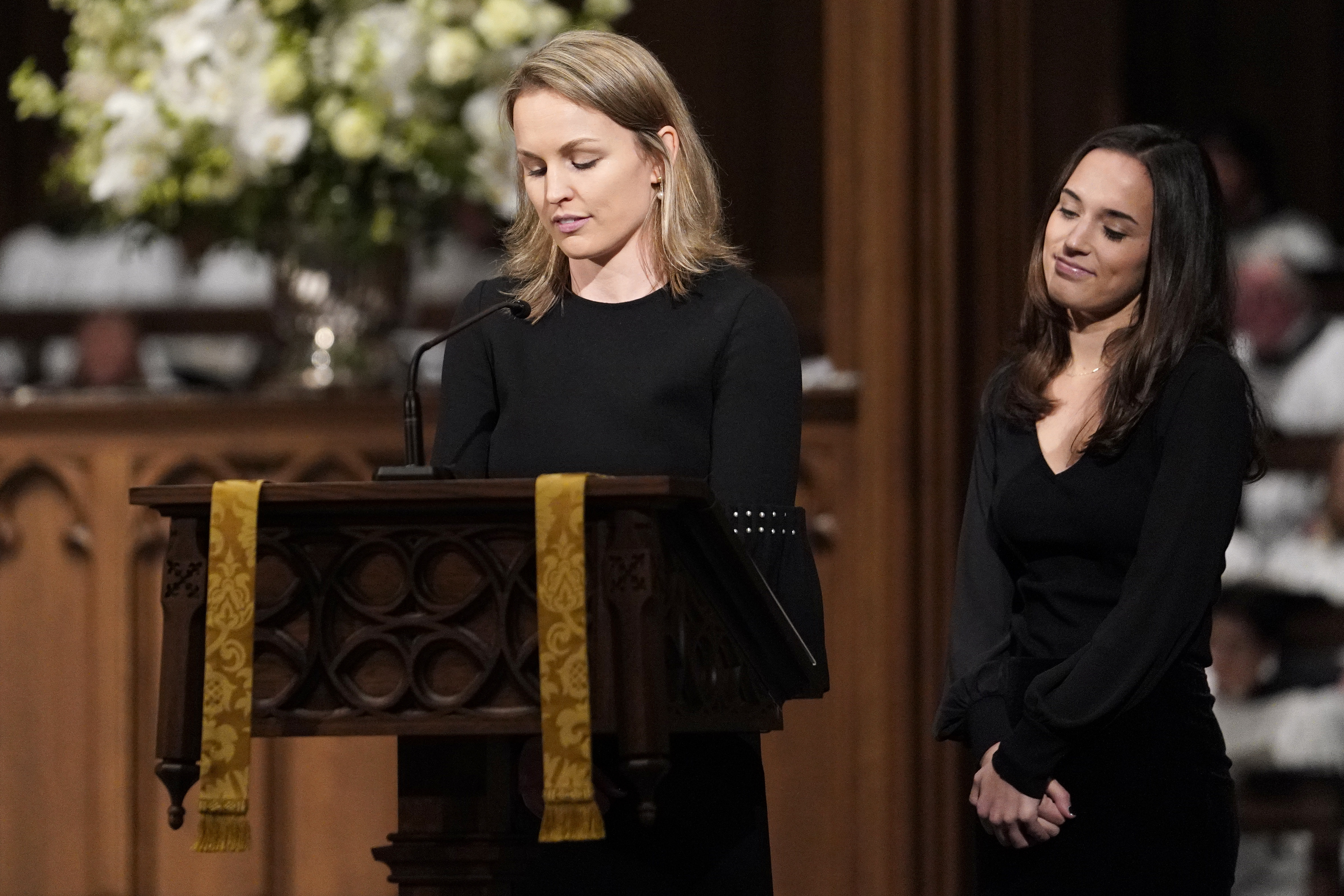 Granddaughters Nancy Ellis LeBlond Sosa, left, and Georgia Grace Koch read scripture during a funeral service for former President George H.W. Bush at St. Martin's Episcopal Church Thursday, Dec. 6, 2018, in Houston.(AP Photo/David J. Phillip, Pool)
