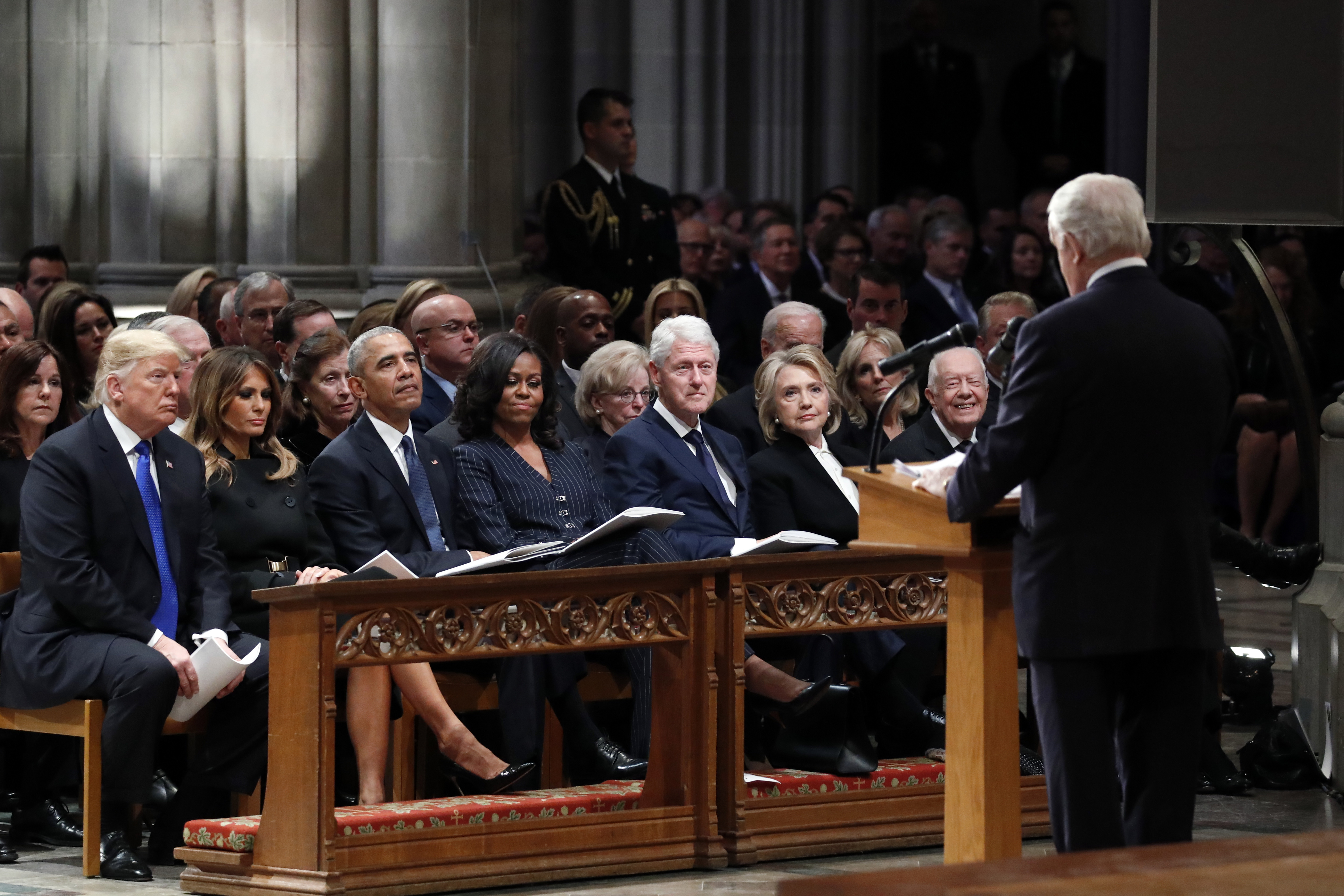 From left, President Donald Trump, first lady Melania Trump, former President Barack Obama, Michelle Obama, former President Bill Clinton, former Secretary of State Hillary Clinton, and former President Jimmy Carter listen as former Canadian Prime Minister Brian Mulroney speaks during a State Funeral at the National Cathedral, Wednesday, Dec. 5, 2018, in Washington, for former President George H.W. Bush. (AP Photo/Alex Brandon, Pool)